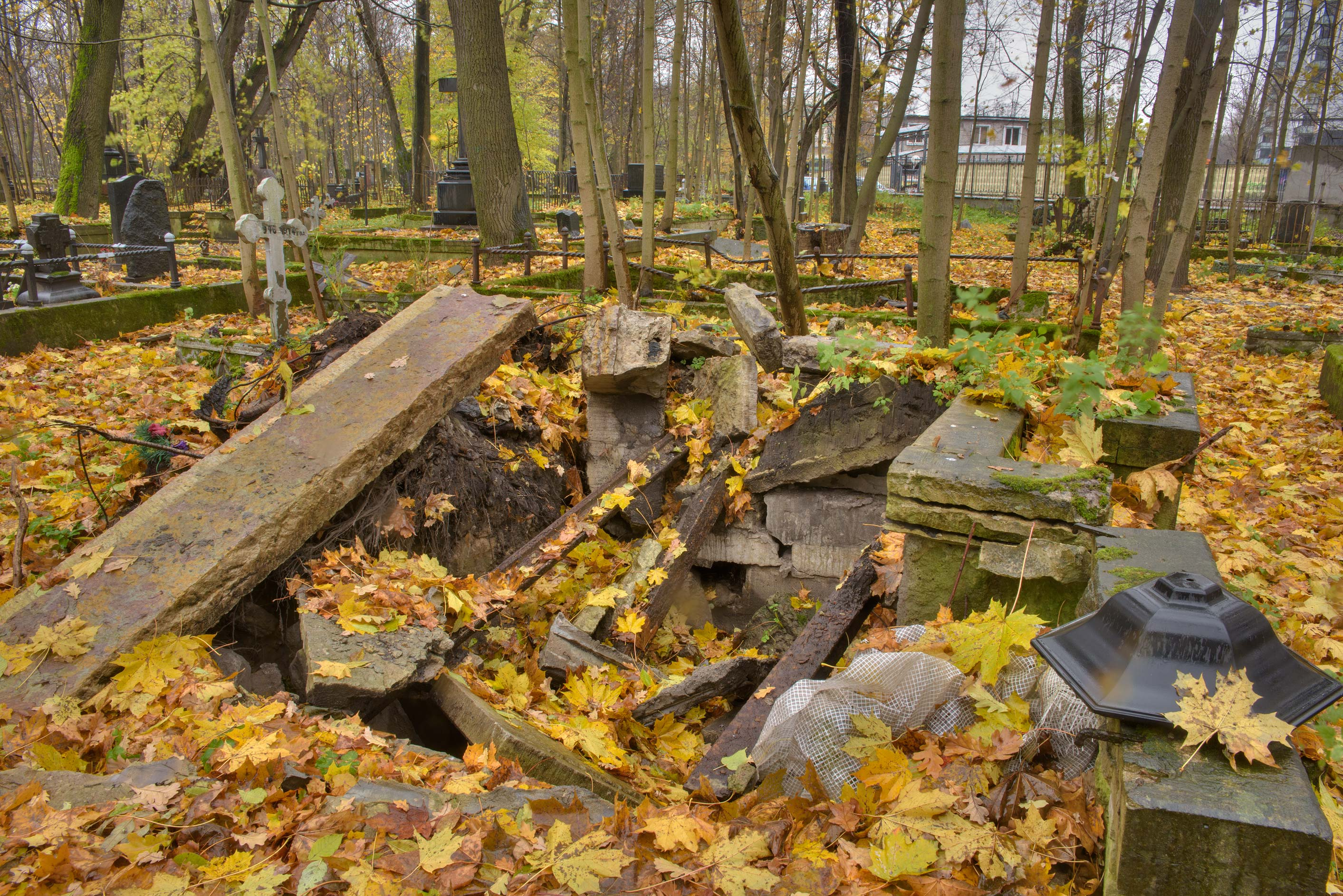 Crashed tomb in Smolenskoe Lutheran Cemetery on Dekabristov Island. St.Petersburg, Russia
