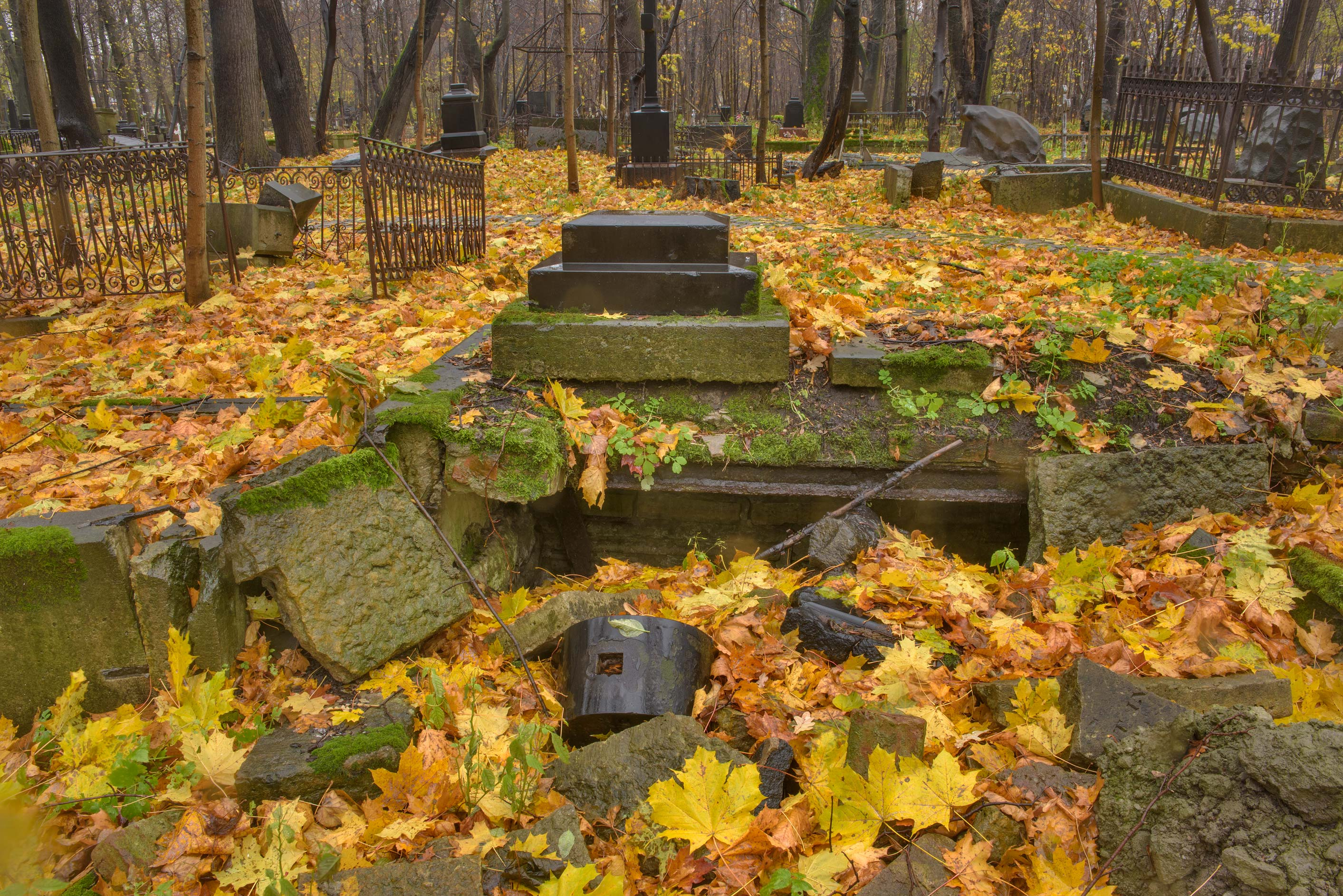 Tomb turned to rubble in Smolenskoe Lutheran...Island. St.Petersburg, Russia