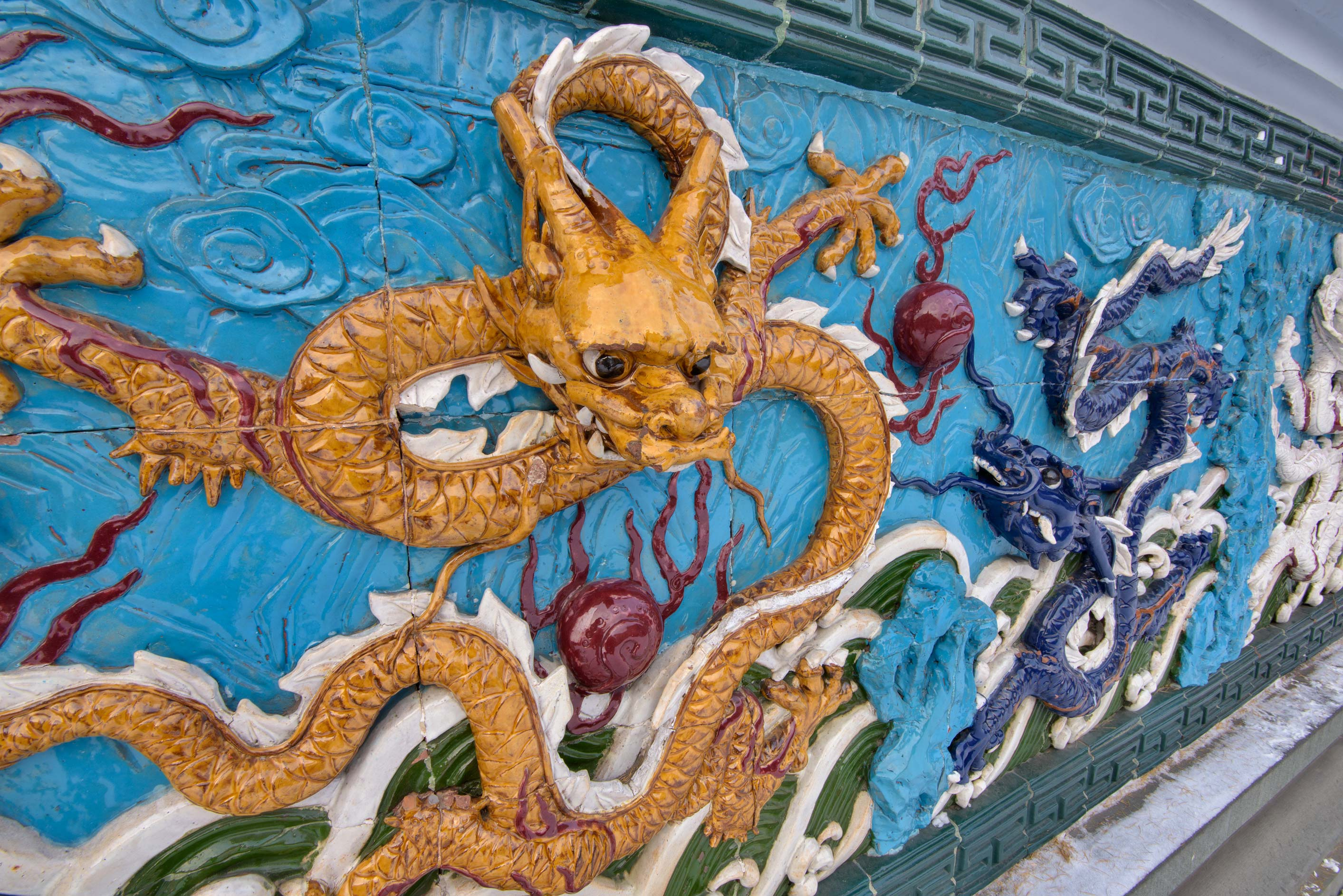 Nine Dragon Wall of Shankhay Friendship Garden on Liteyny Prospect. St.Petersburg, Russia