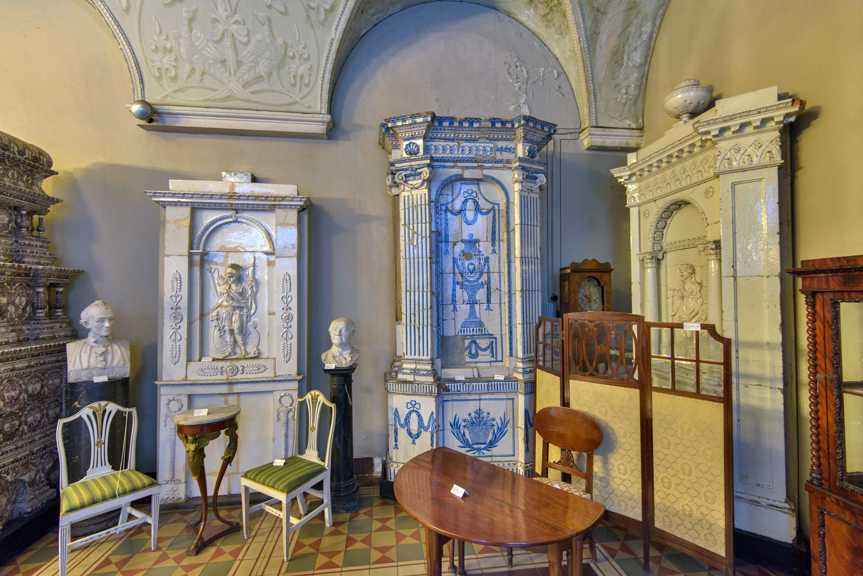 Old fireplaces in ceramics hall in Stieglitz Museum of Applied Arts. St.Petersburg, Russia