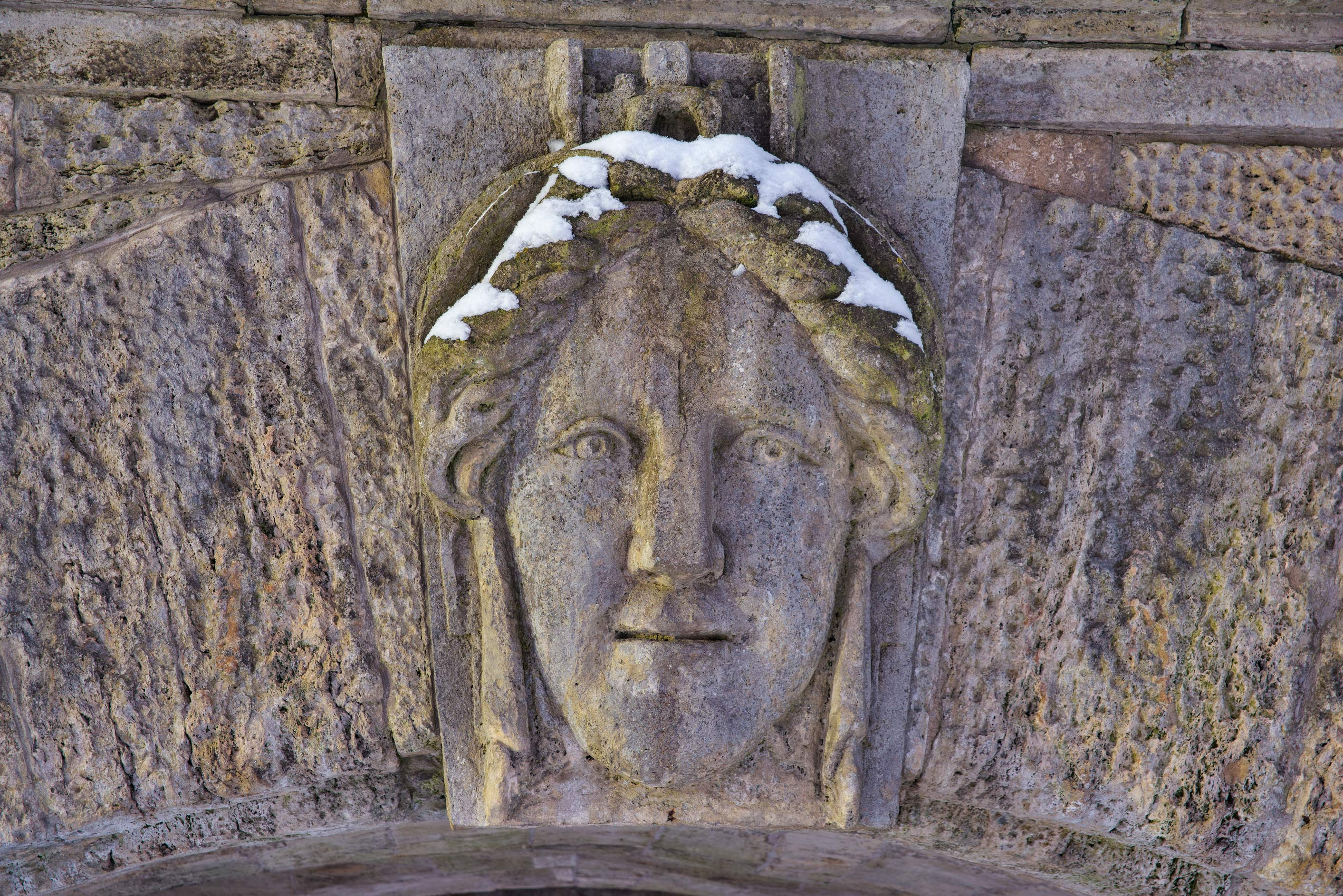 Stone face on an arch of a ramp of Cameron...Selo) near St.Petersburg, Russia