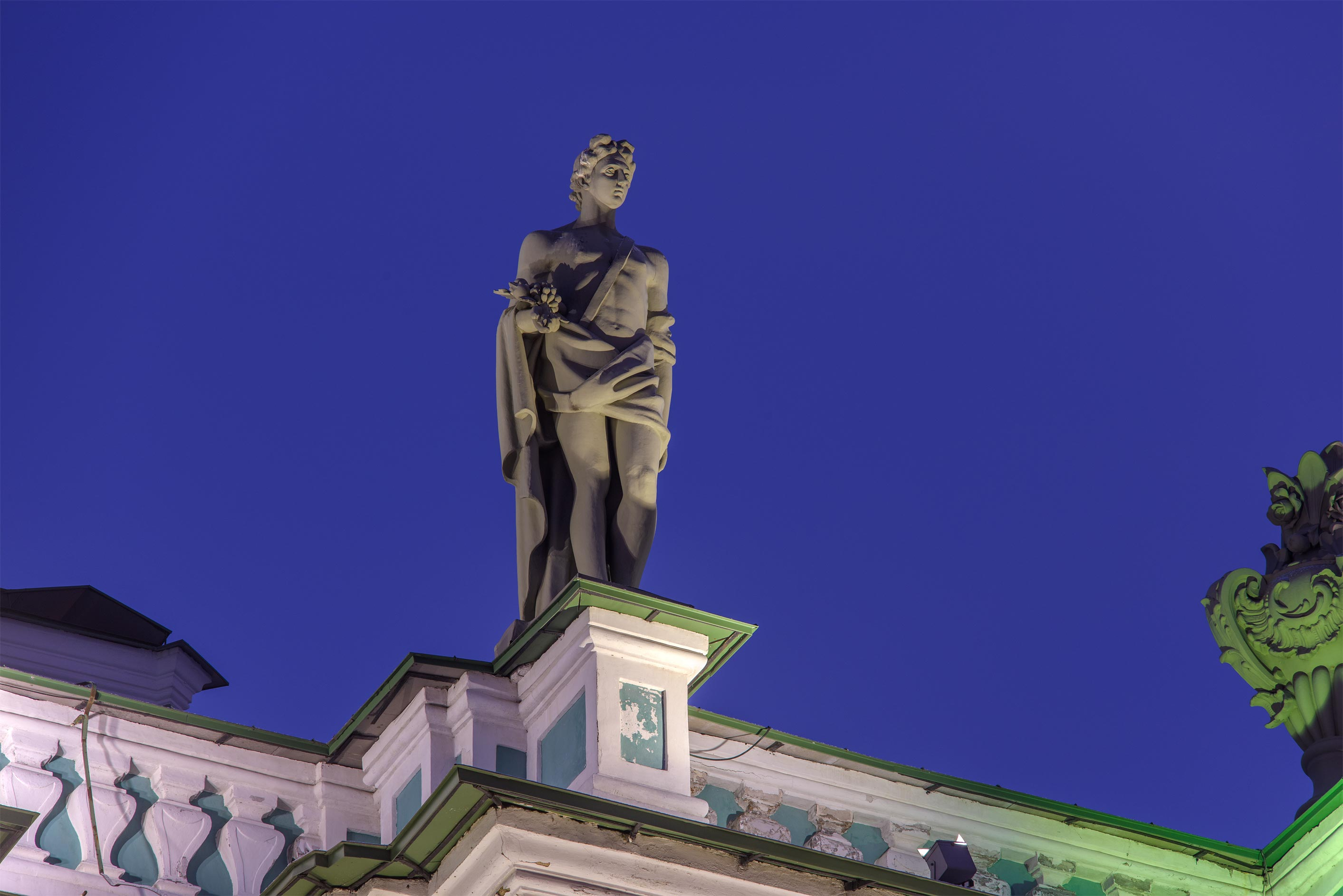 Sculpture on the roof of Winter Palace on Palace Embankment. St.Petersburg, Russia