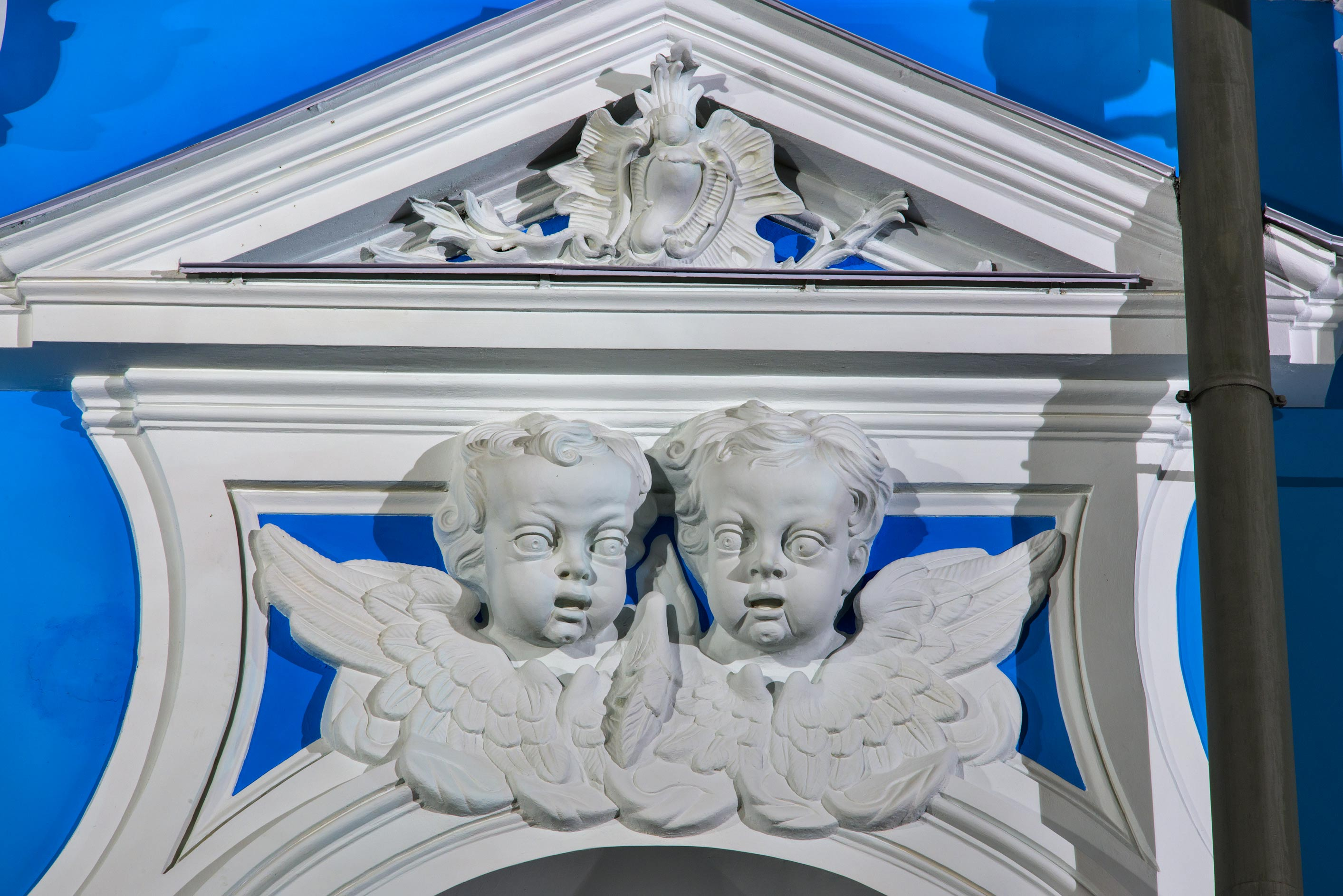 Pair of angels above a window of Smolny Cathedral. St.Petersburg, Russia