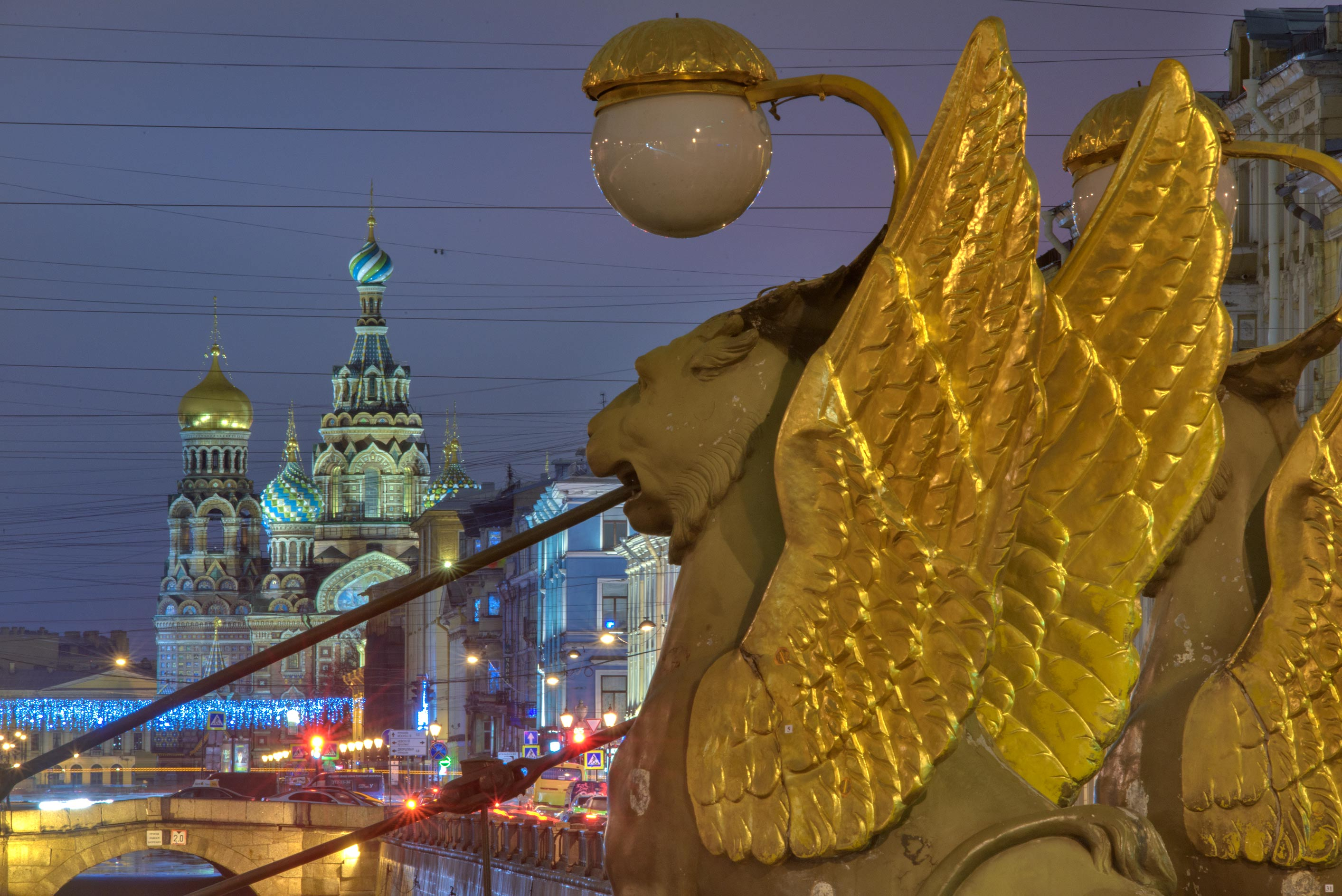 Gryphons of Bank Bridge of Griboedova Canal, with...in background. St.Petersburg, Russia