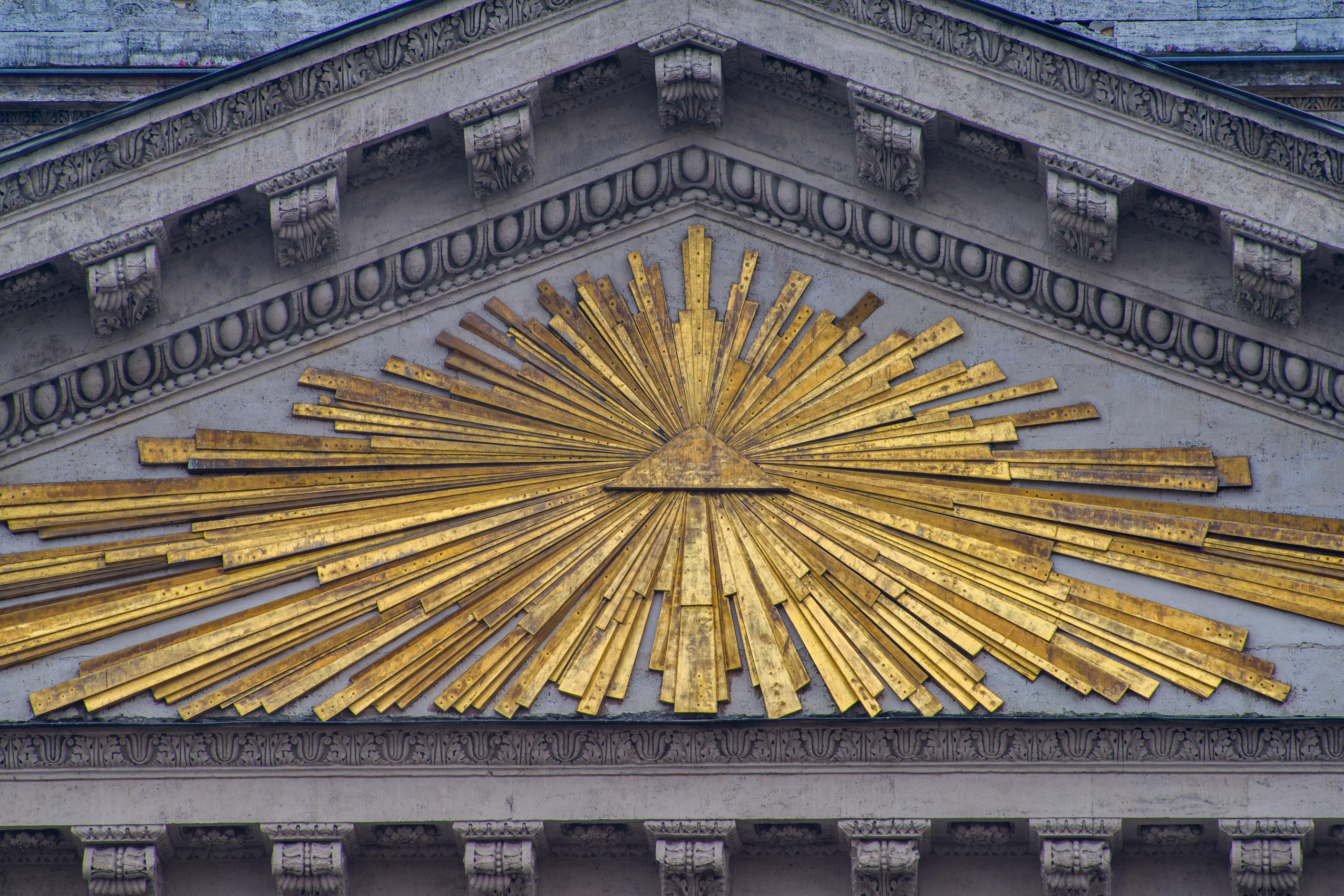 Triangular symbol on a pediment of Kazansky Cathedral. St.Petersburg, Russia
