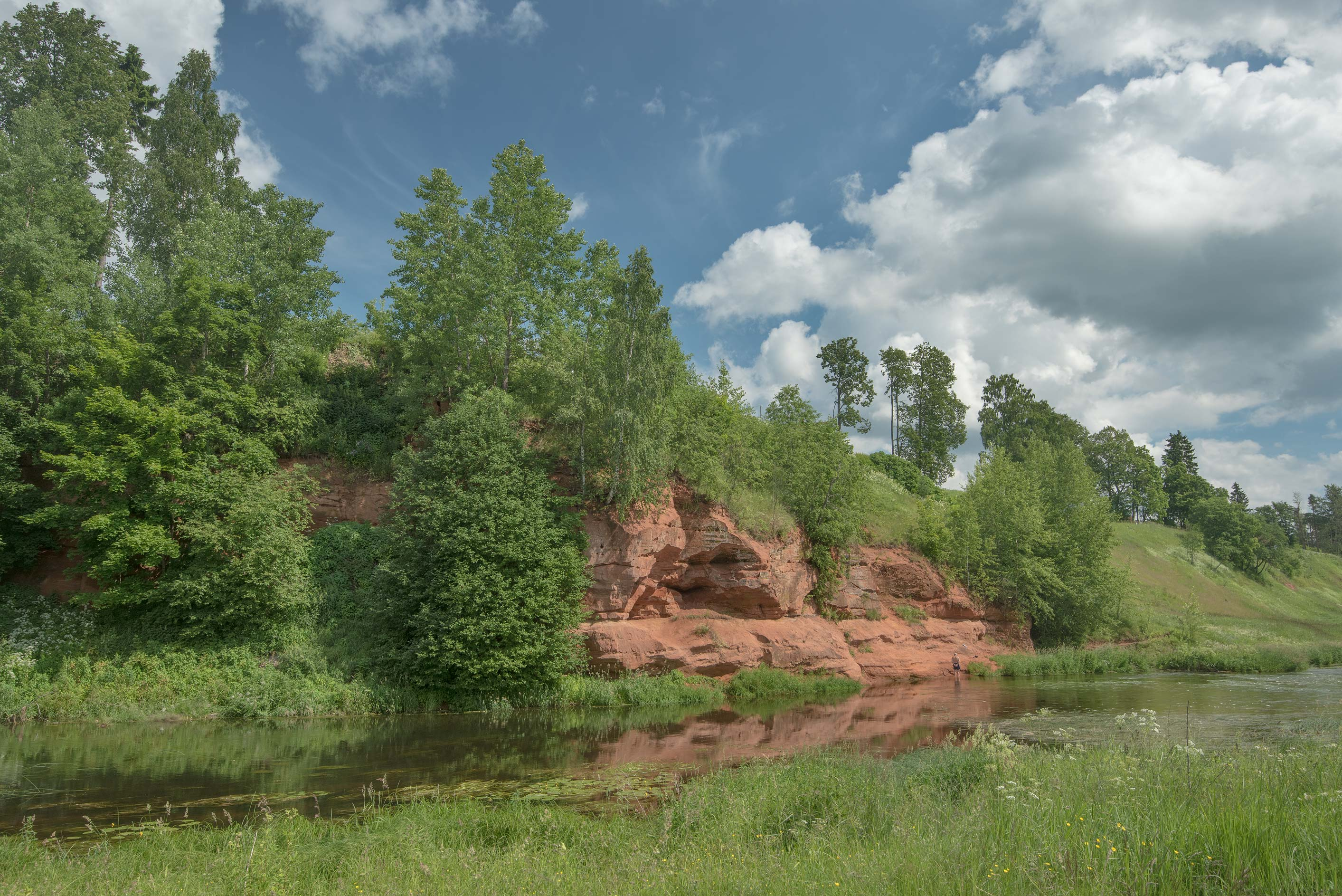Red sand cliffs of Oredezh River near Kezevo in...miles south from St.Petersburg. Russia