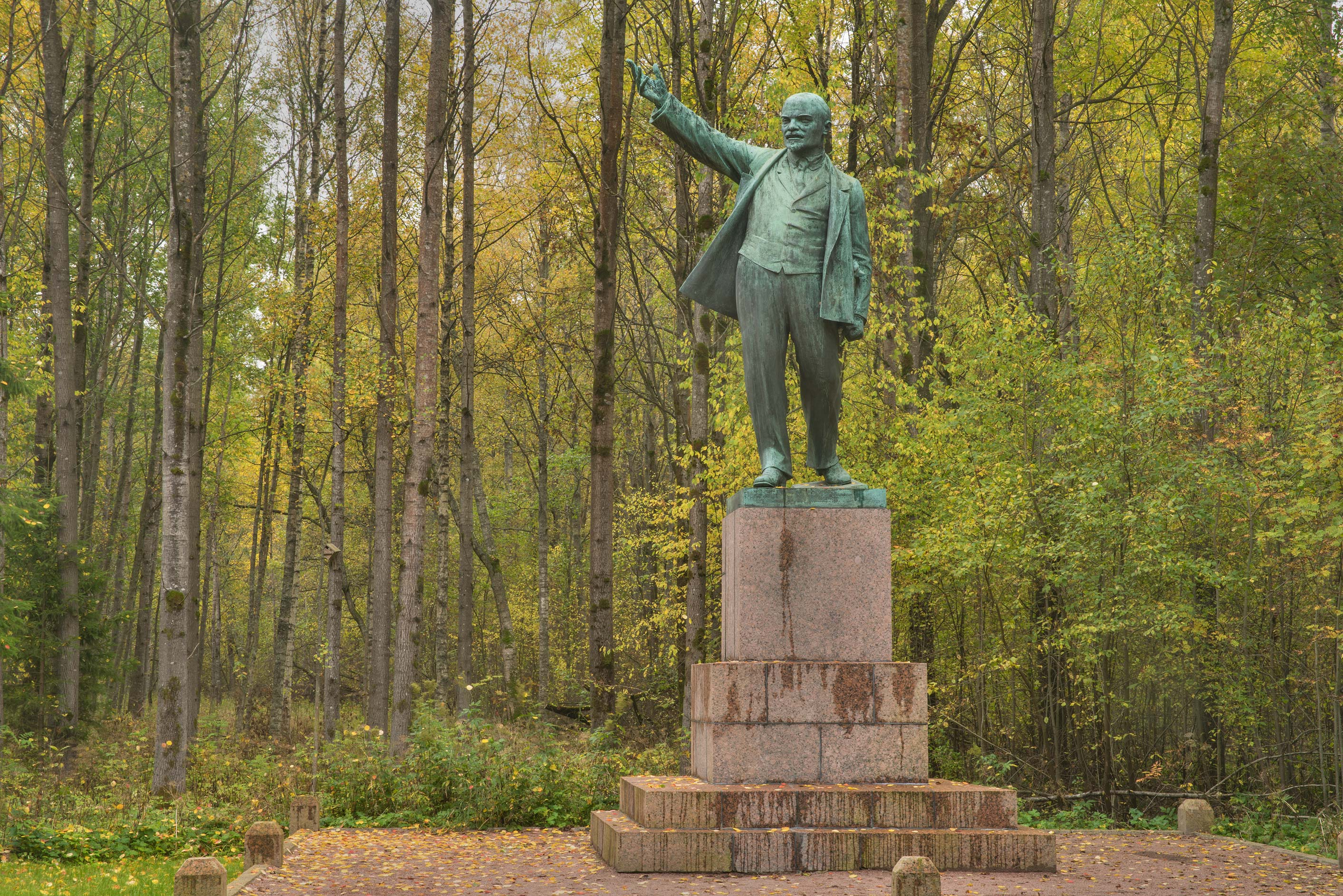 Fall colors around a bronze monument of Russian...north-west from St.Petersburg. Russia