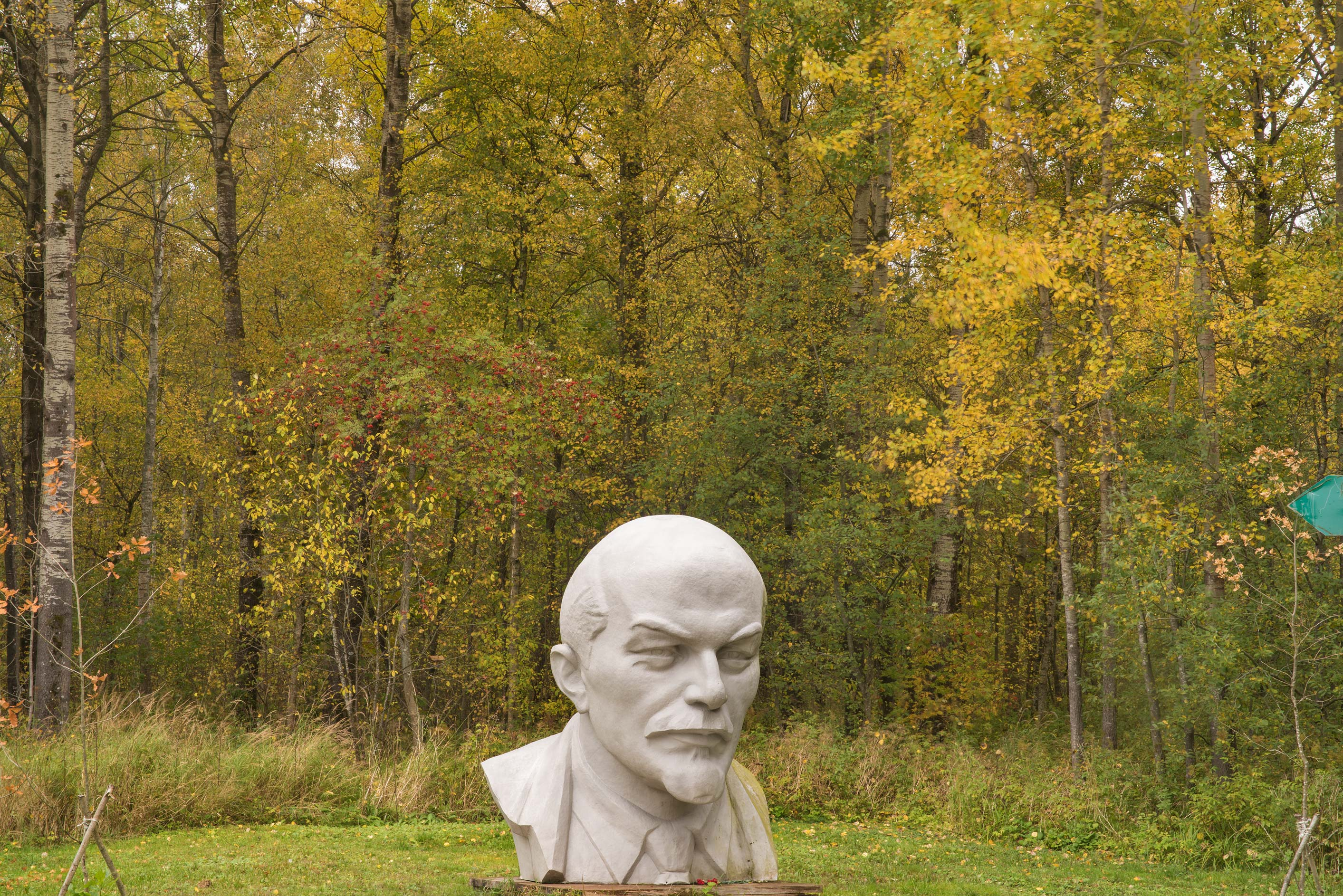 Stone head of Russian revolutioner V. I. Lenin in...north-west from St.Petersburg. Russia