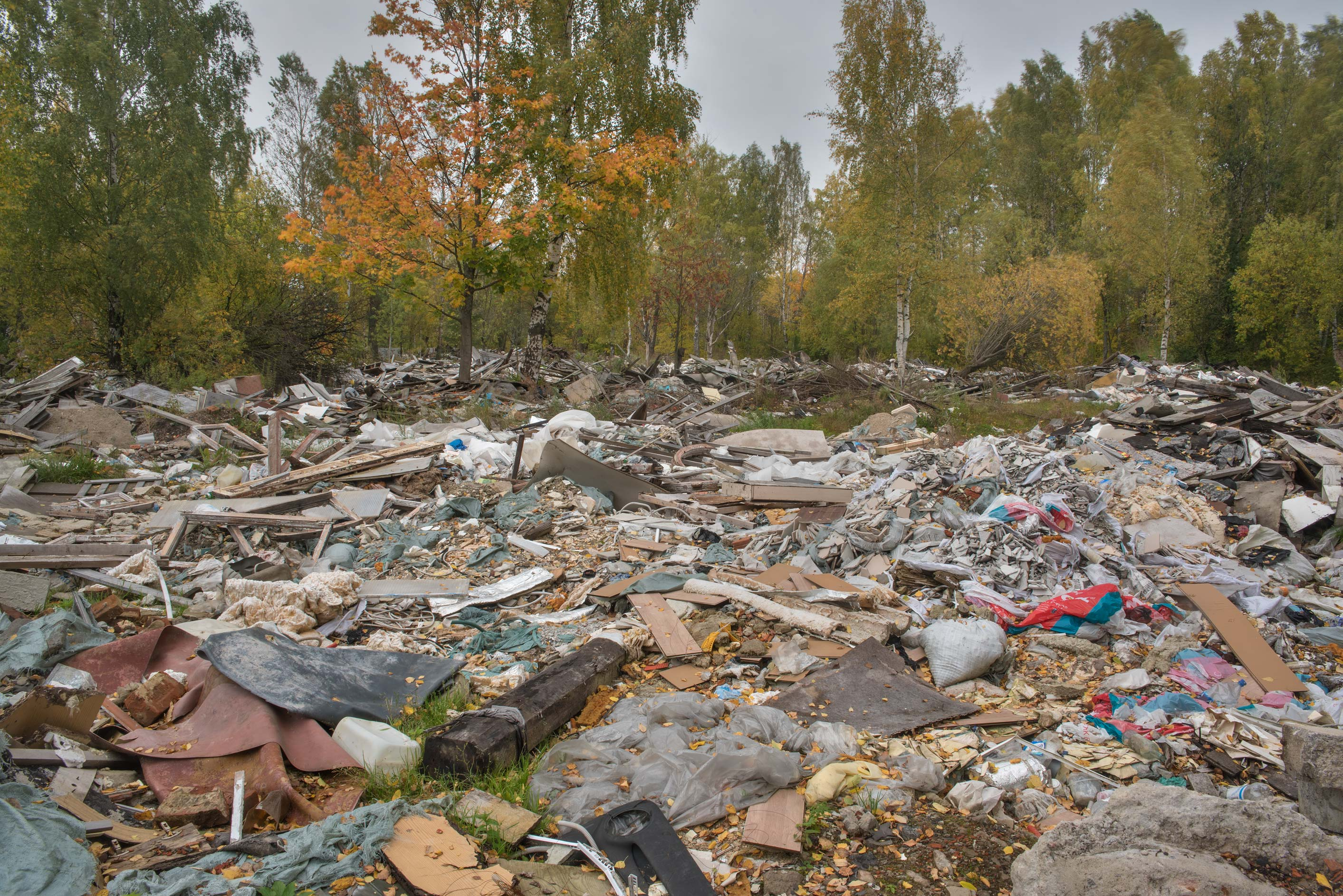 Demolished garages in area of former labor camps in Sosnovka Park. St.Petersburg, Russia