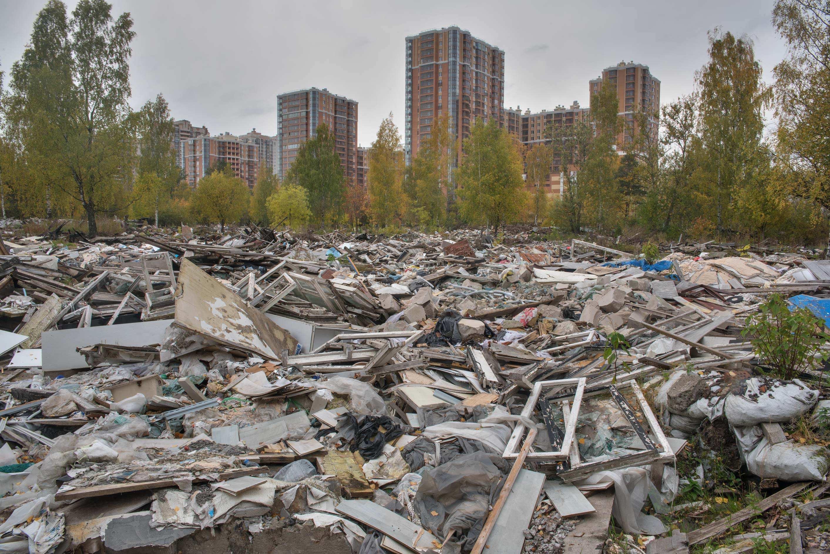 Demolished garages in northern area in Sosnovka Park. St.Petersburg, Russia