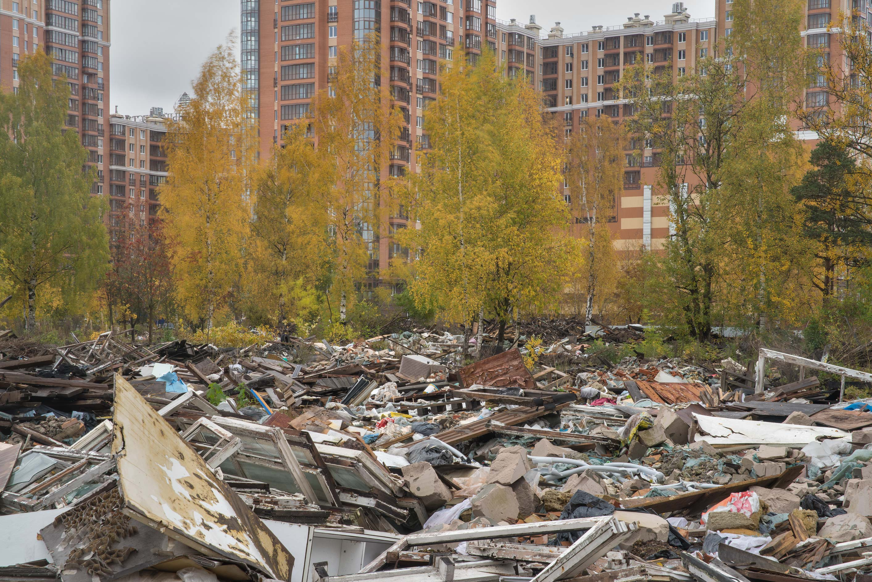Fall colors of demolished garages in area of...Sosnovka Park. St.Petersburg, Russia