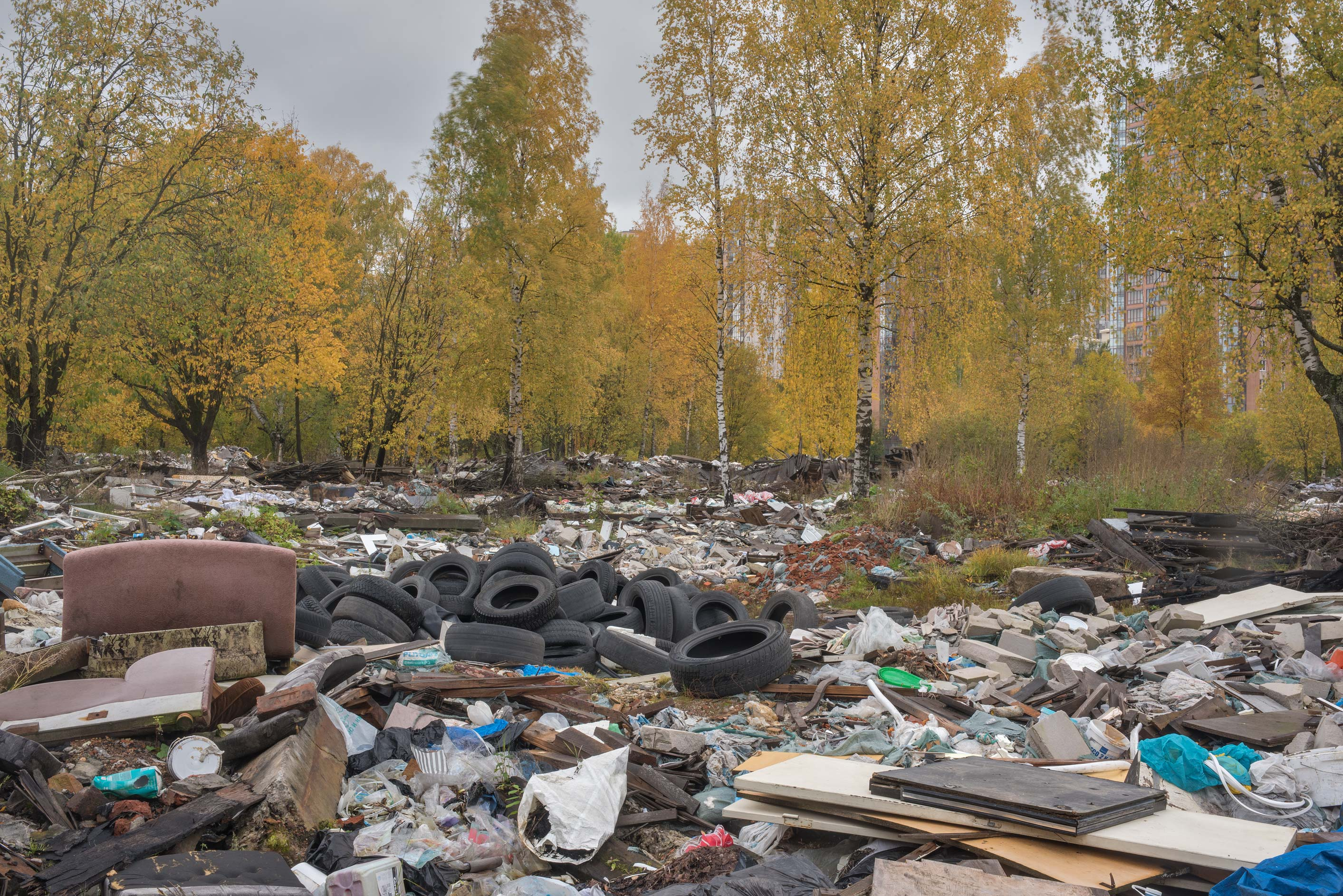 Various trash from demolished garages in area of...Sosnovka Park. St.Petersburg, Russia