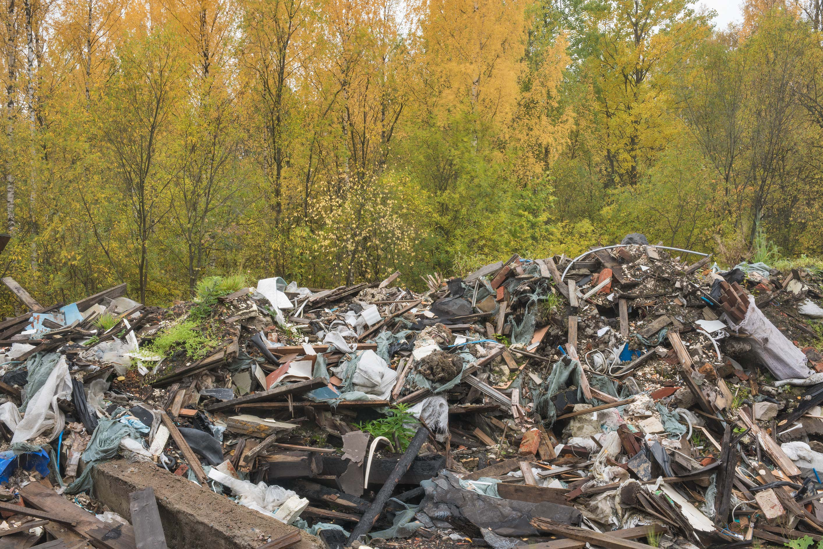 Piles of garbage from demolished garages in area...Sosnovka Park. St.Petersburg, Russia