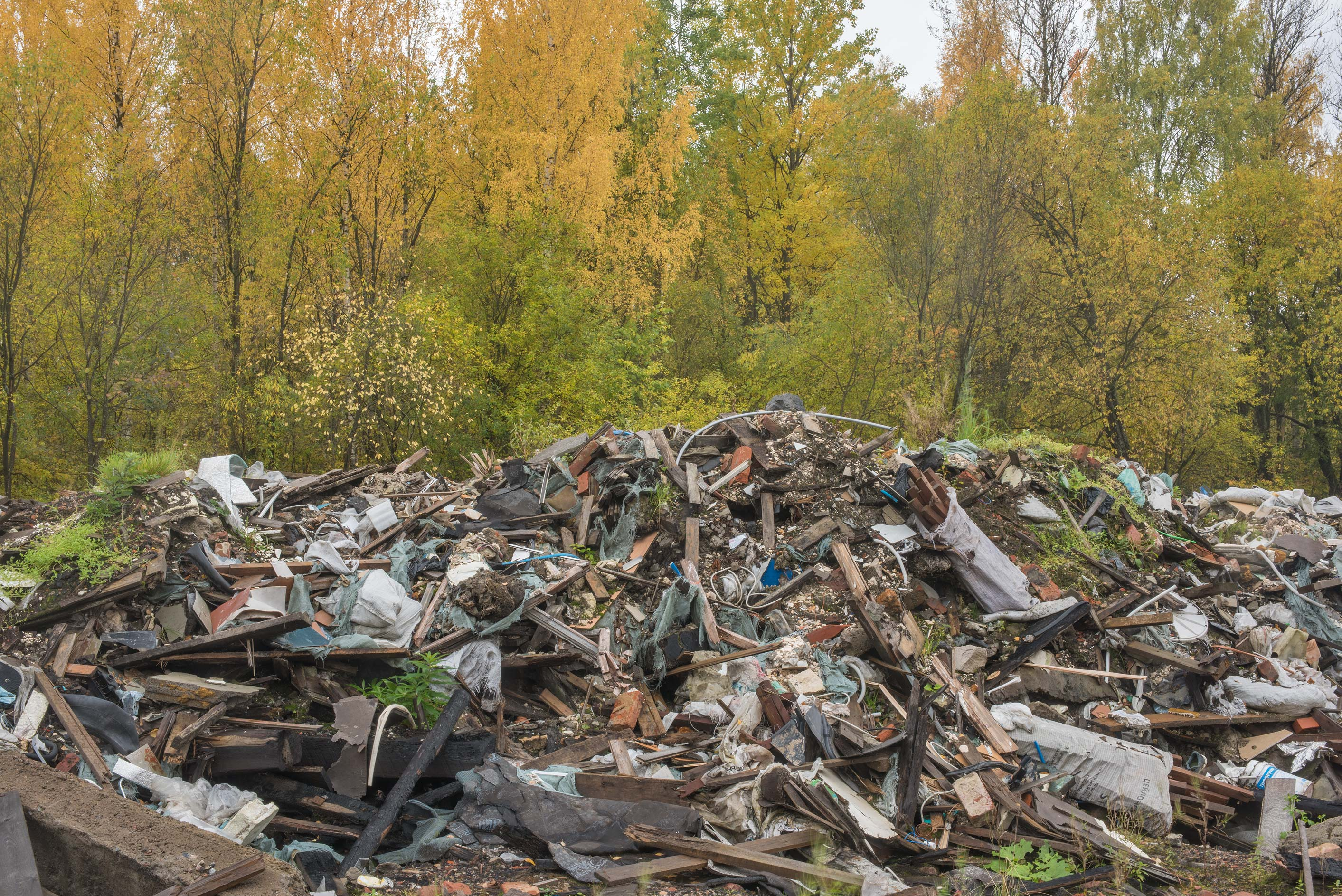 Accumulation of trash from demolished garages in...Sosnovka Park. St.Petersburg, Russia