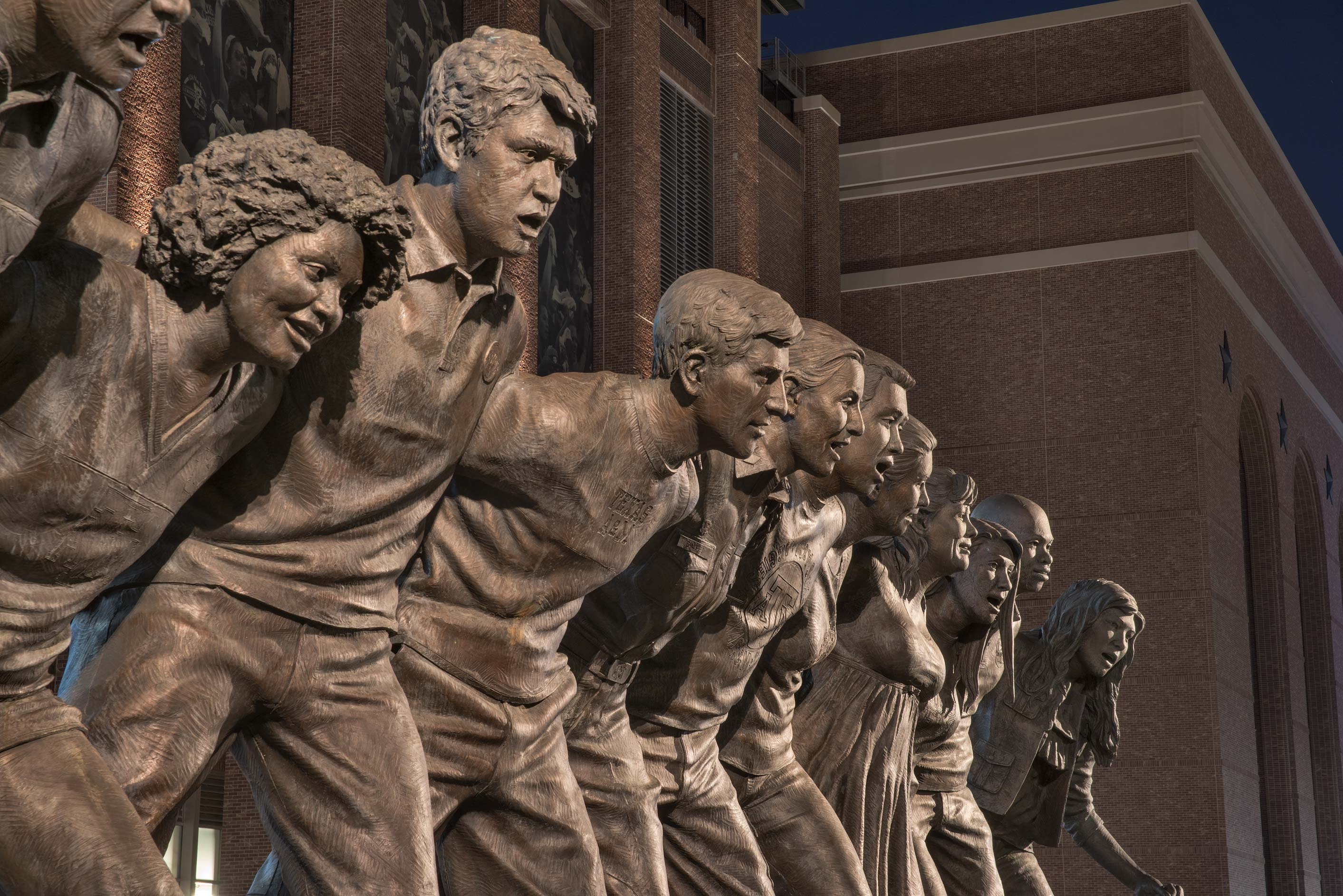 Details of bronze figures of 12 students on War...A&M University. College Station, Texas