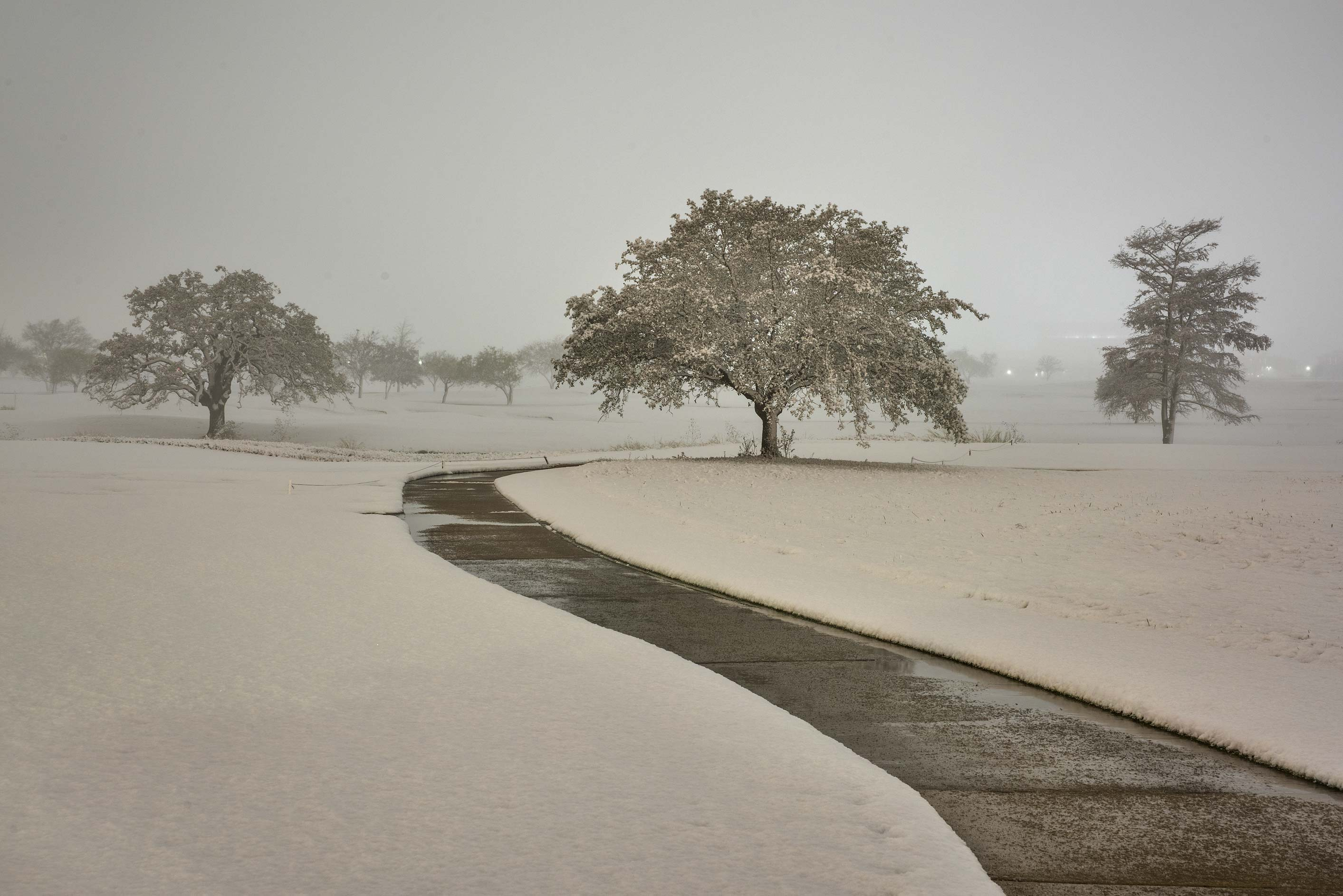Snowy path on the university golf course. College Station, Texas