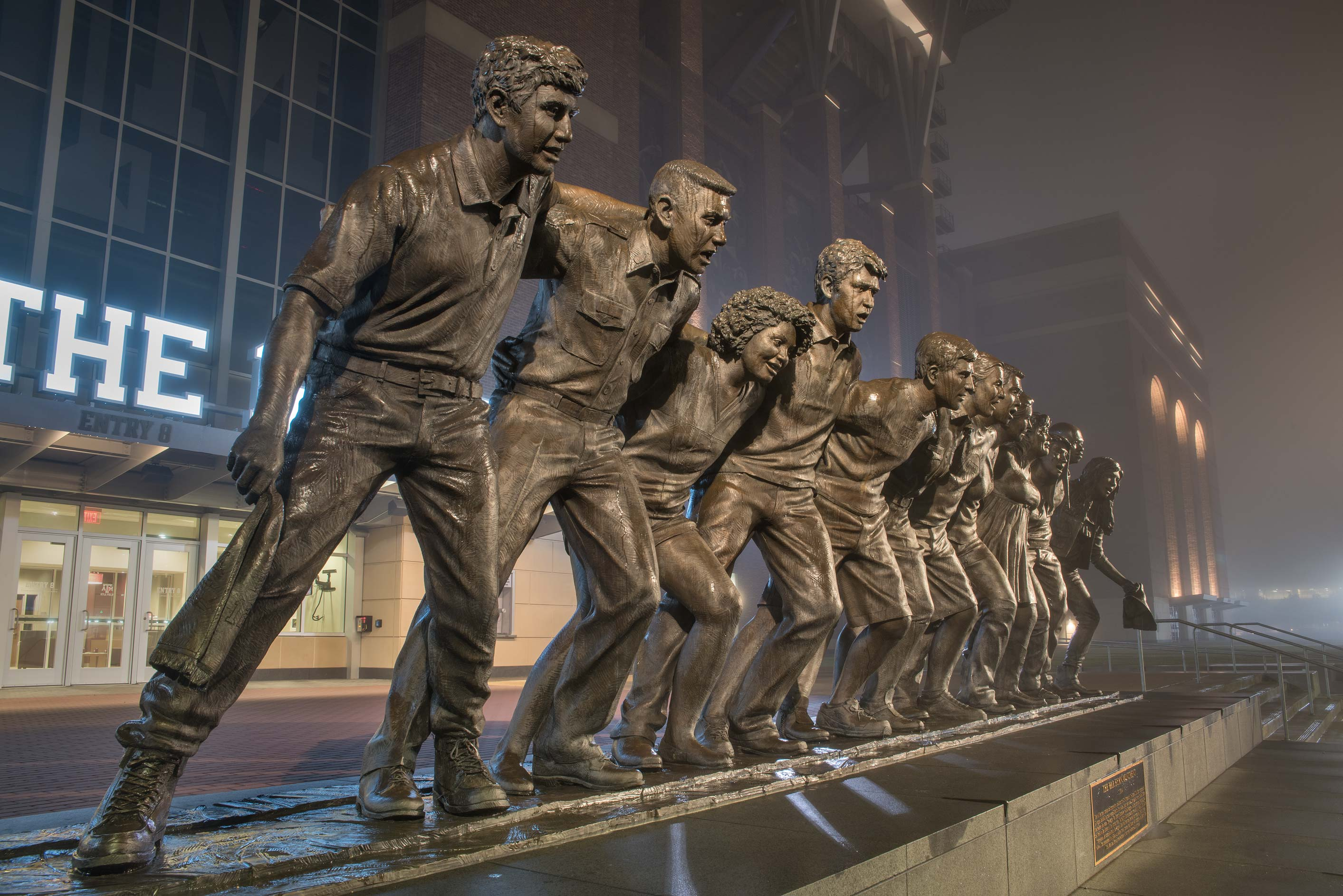 Bronze figures of 12 students standing together...A&M University. College Station, Texas