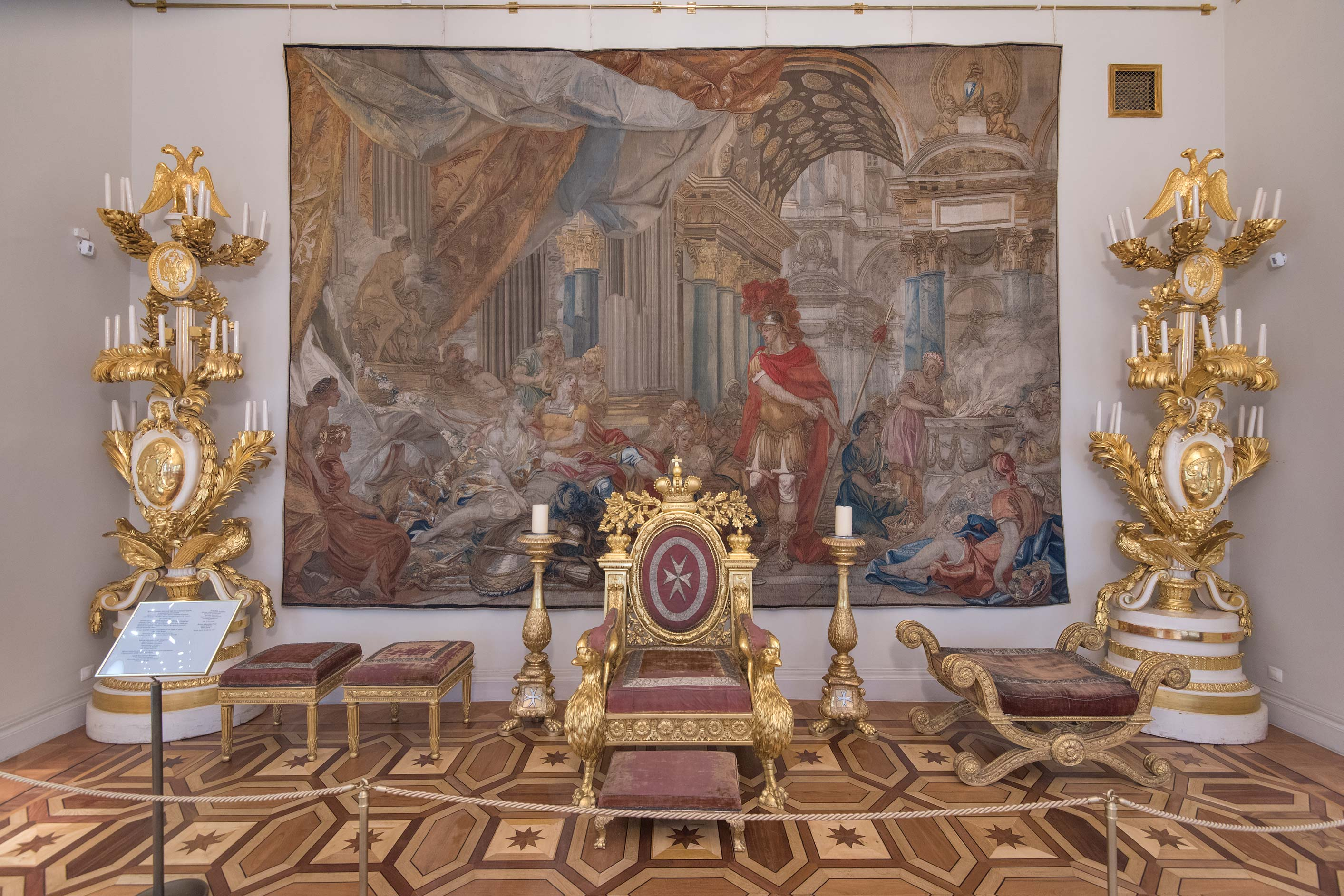 An old throne with tapestry in Hermitage Museum. St.Petersburg, Russia
