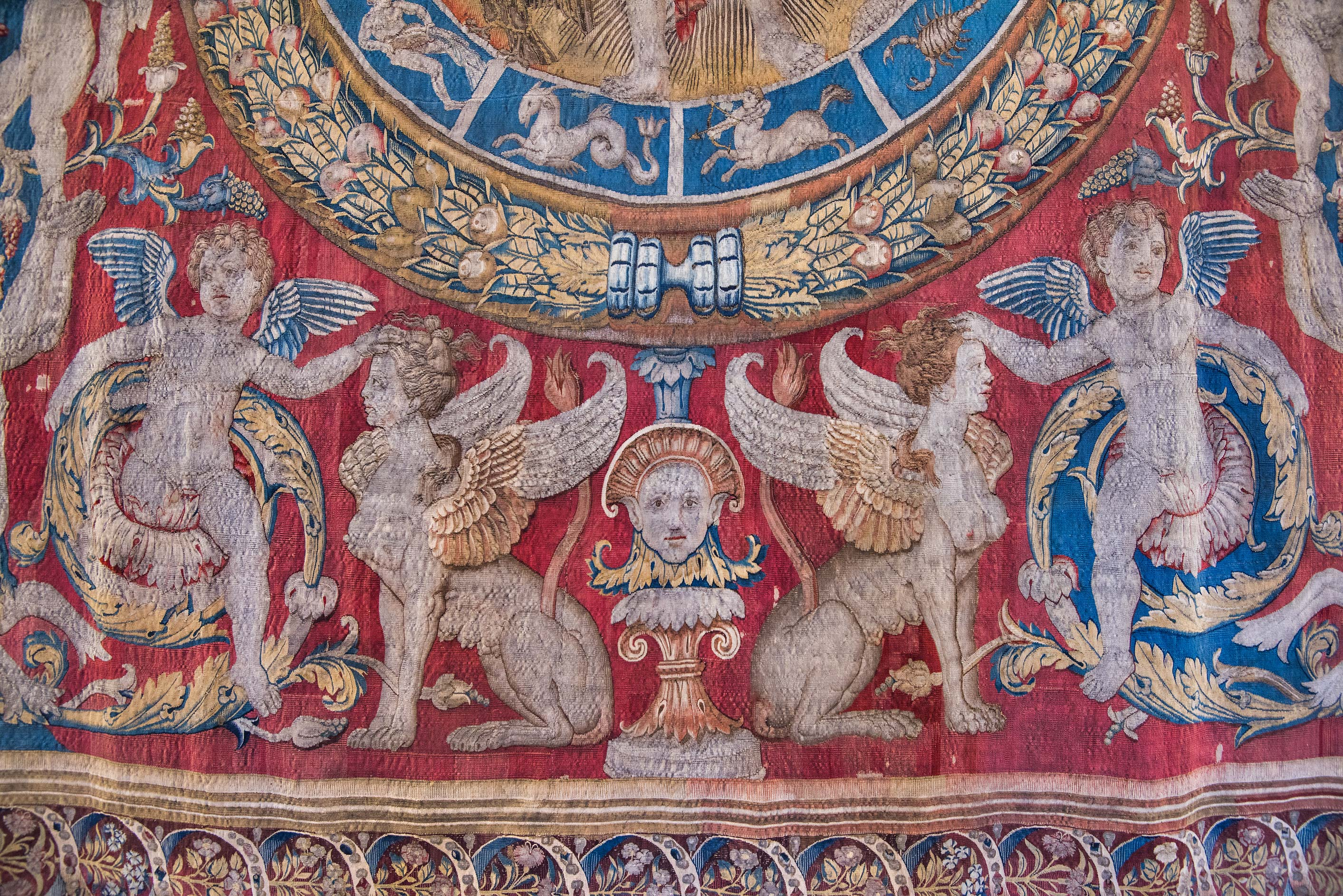 Winged figures on tapestry in Hermitage Museum. St.Petersburg, Russia
