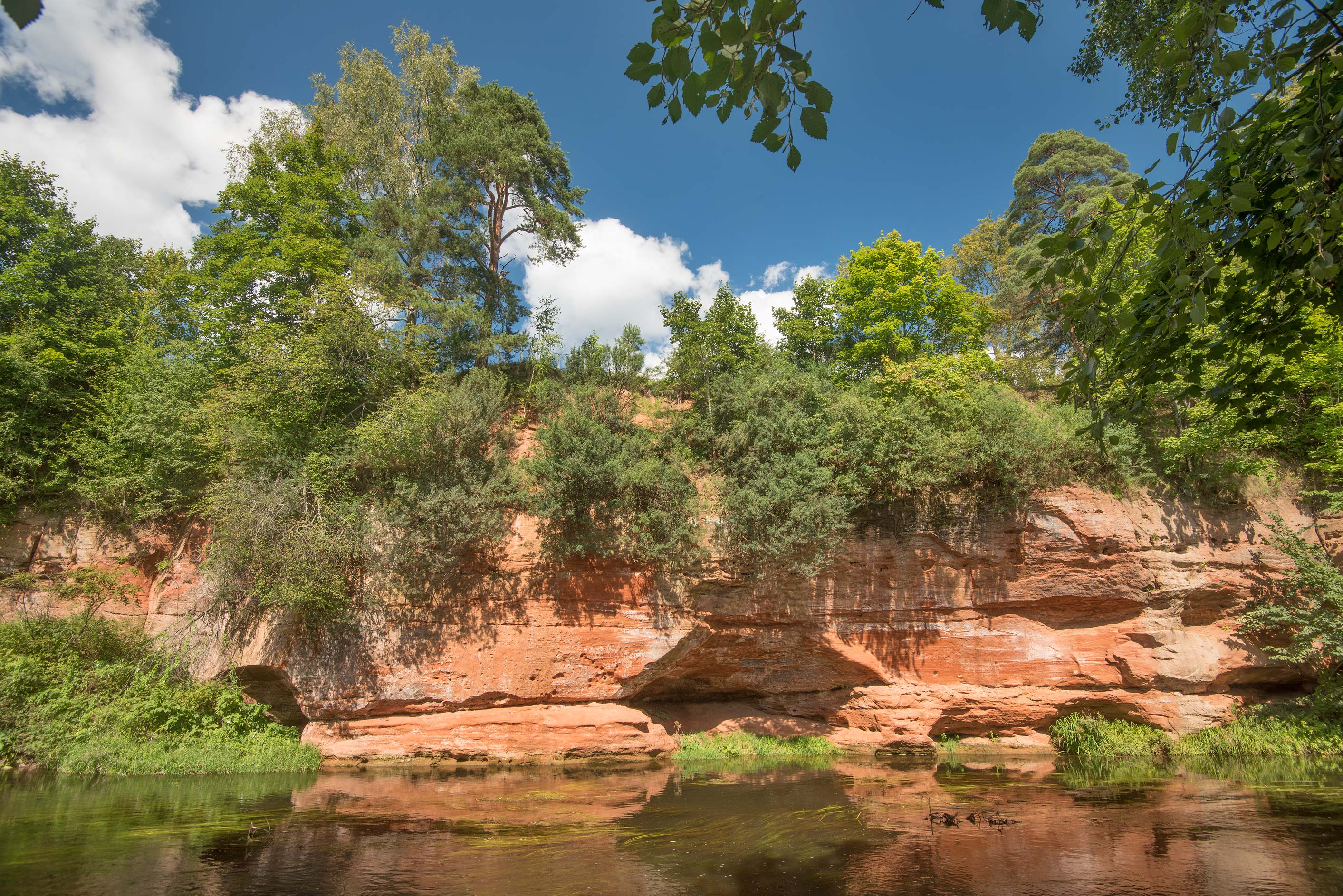 Red sandstone near Oredezh River in Siverskaya, 45 miles south from St.Petersburg. Russia