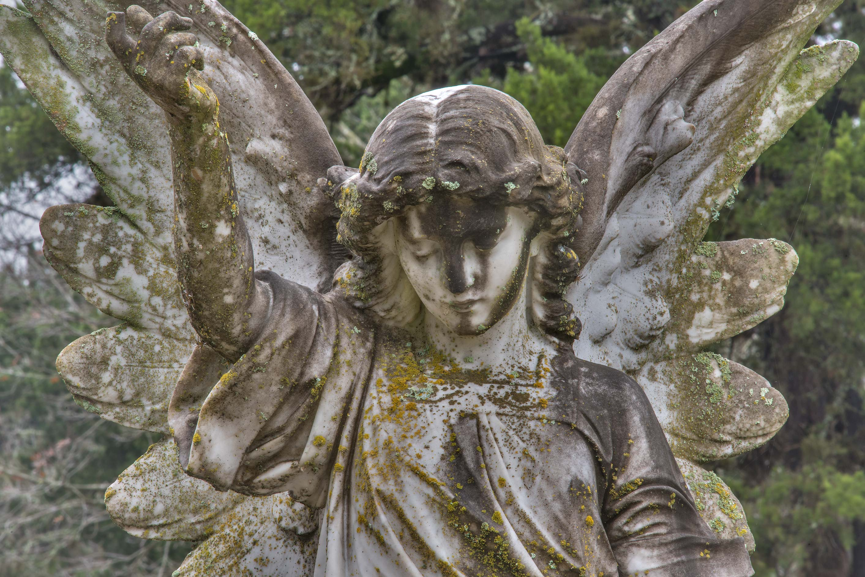 Old marble angel on a tomb in City Cemetery. Bryan, Texas