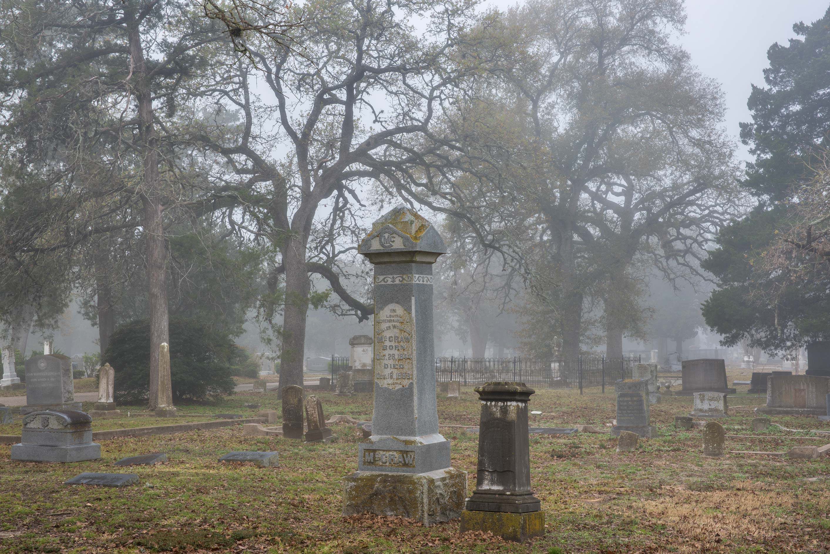 Tombs in mist in City Cemetery. Bryan, Texas