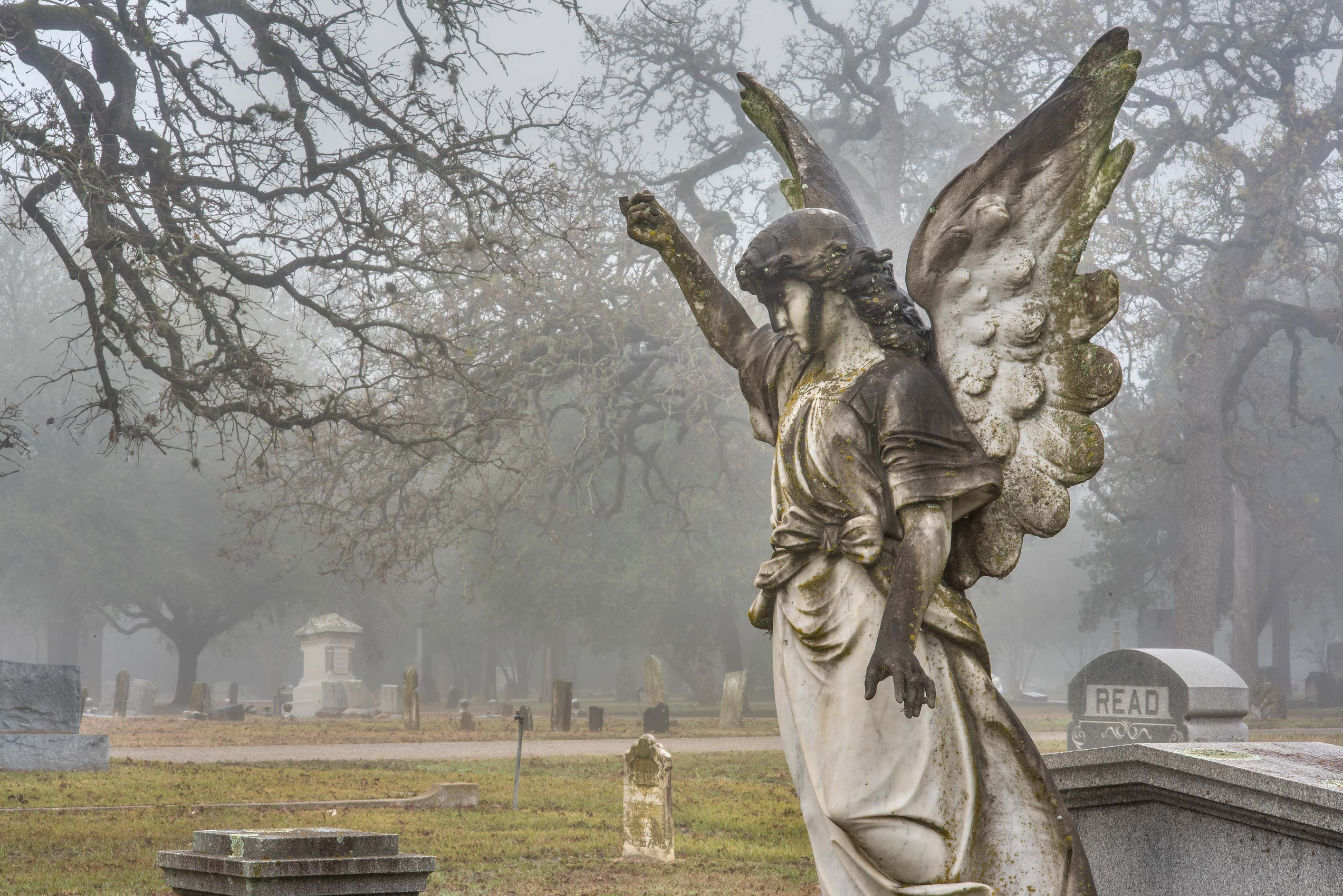 Angel on a tomb of Astin in City Cemetery. Bryan, Texas