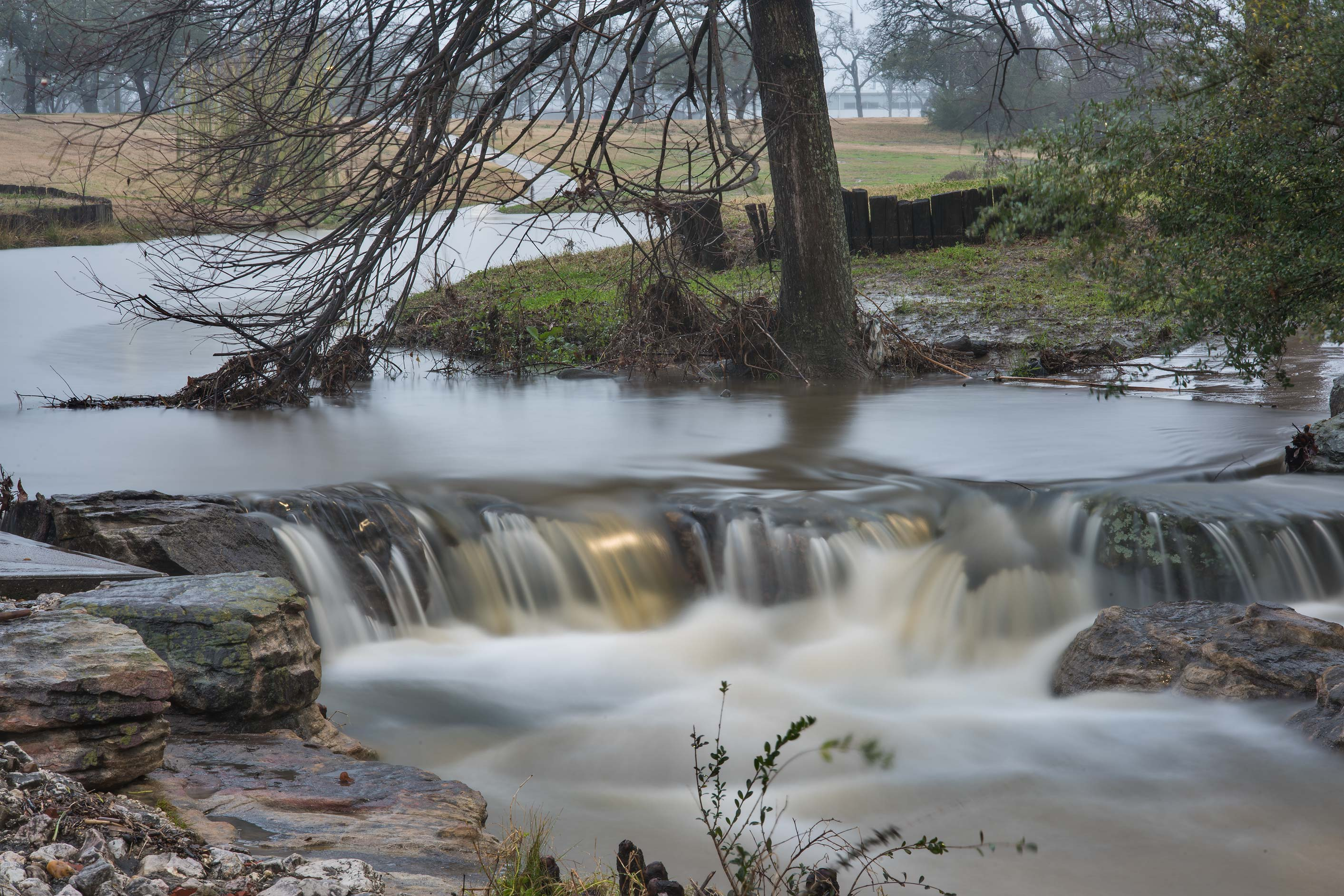 Waterfall over stepping stones after a rain in...M University. College Station, Texas