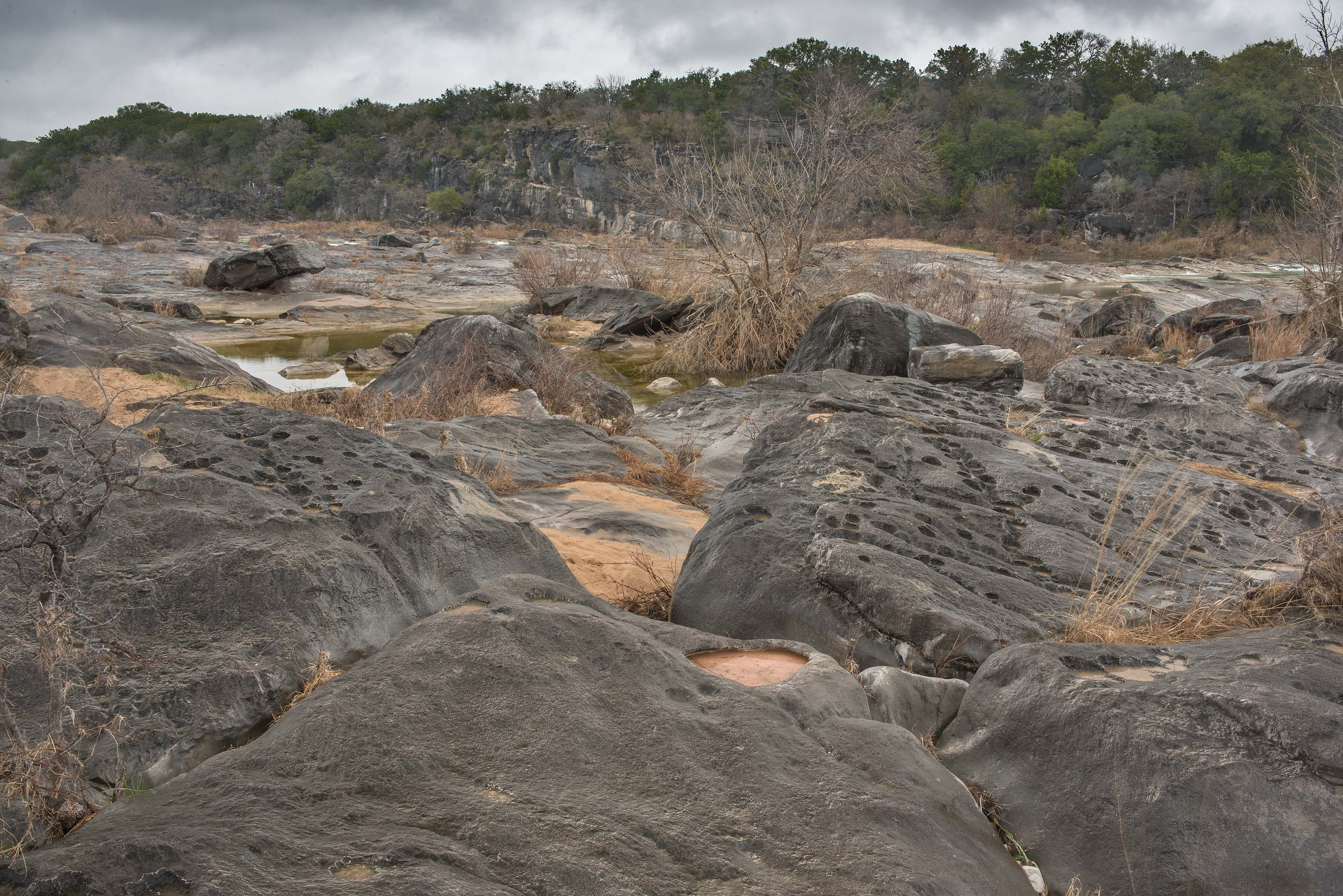 Black limestone rocks in Pedernales Falls State Park. Johnson City, Texas