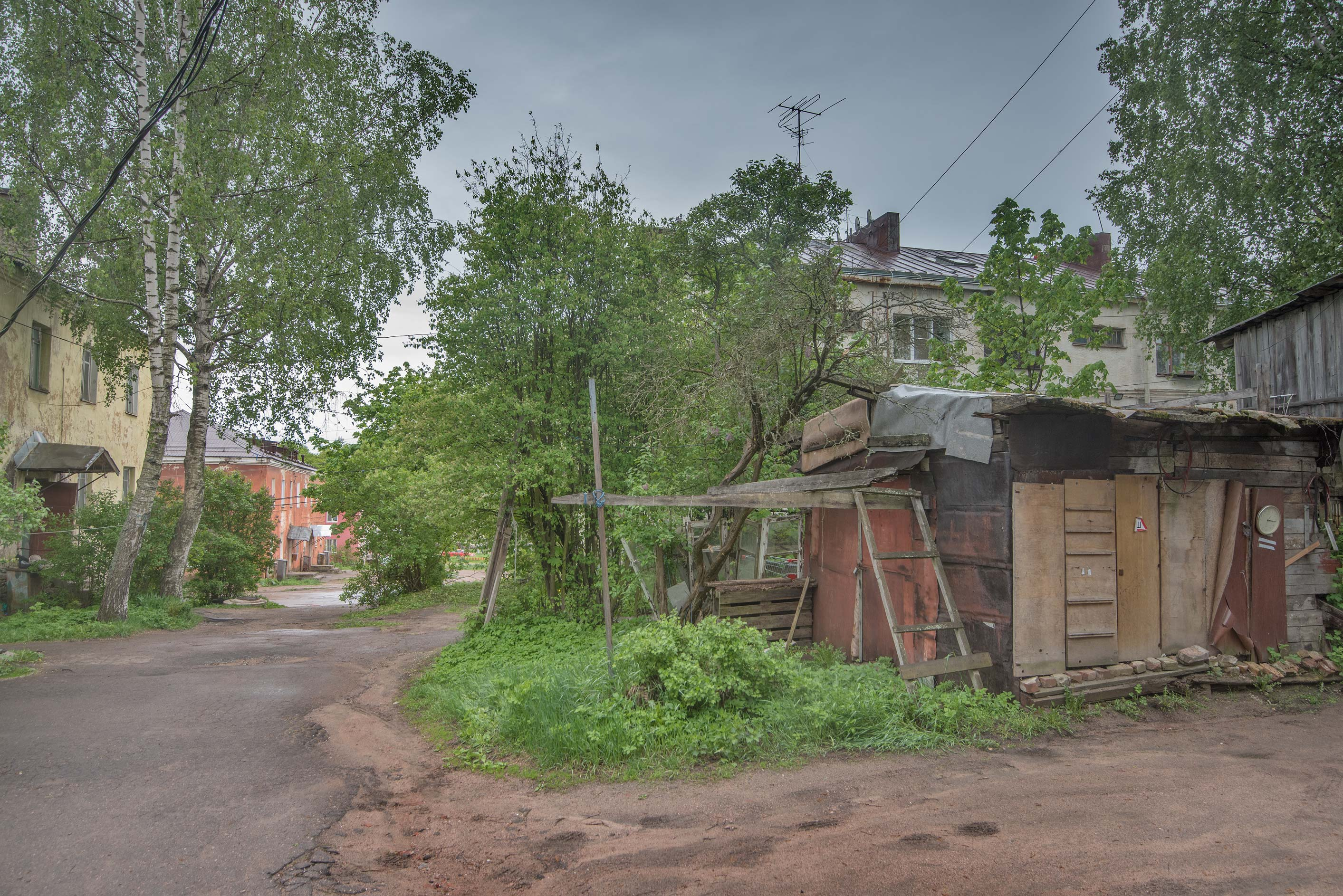 Makeshift storage houses at 6 Okruzhnaya St. in Vyborg. Russia