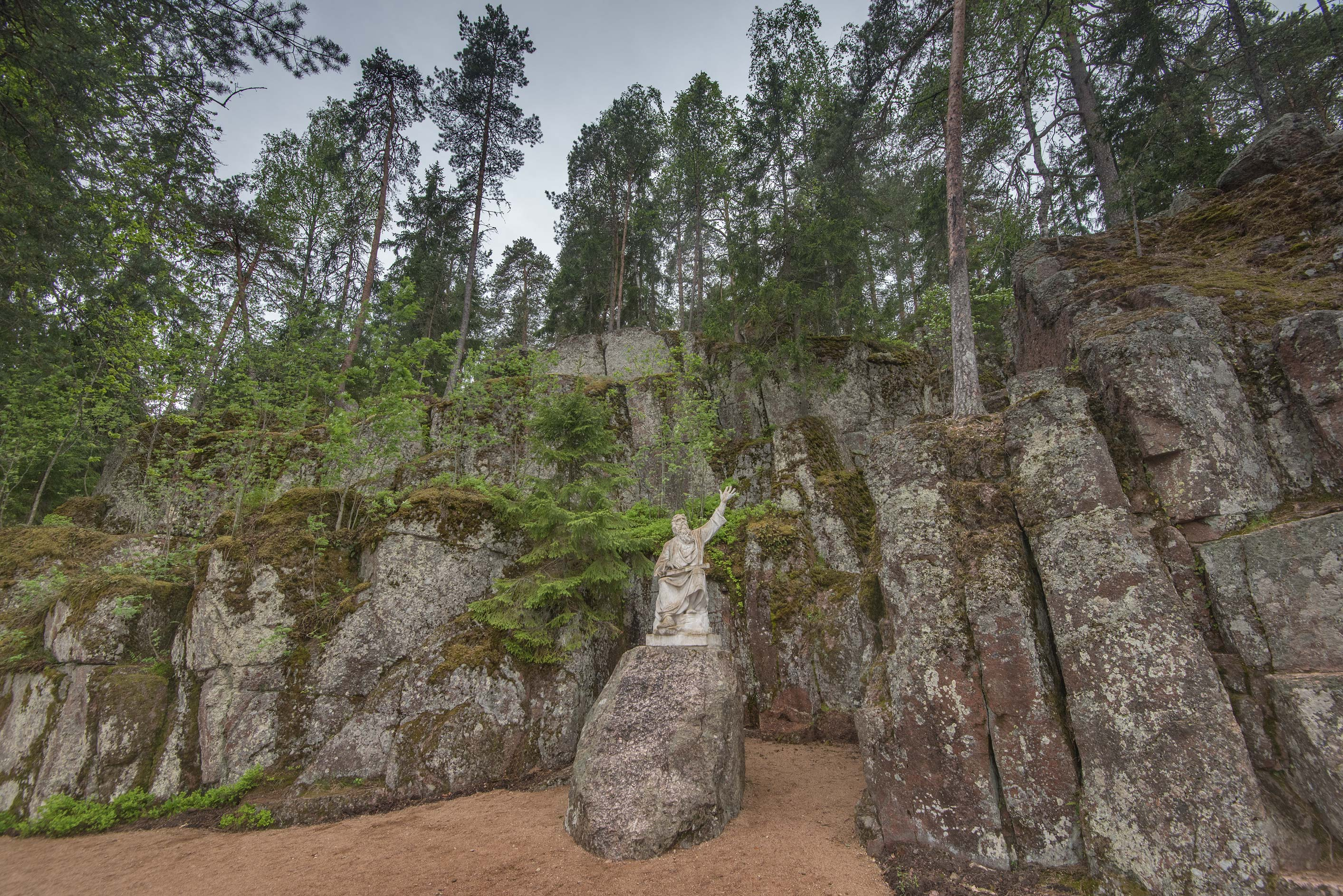 Song of Vainamoinen sculpture below granite cliffs in Monrepos Park in Vyborg. Russia