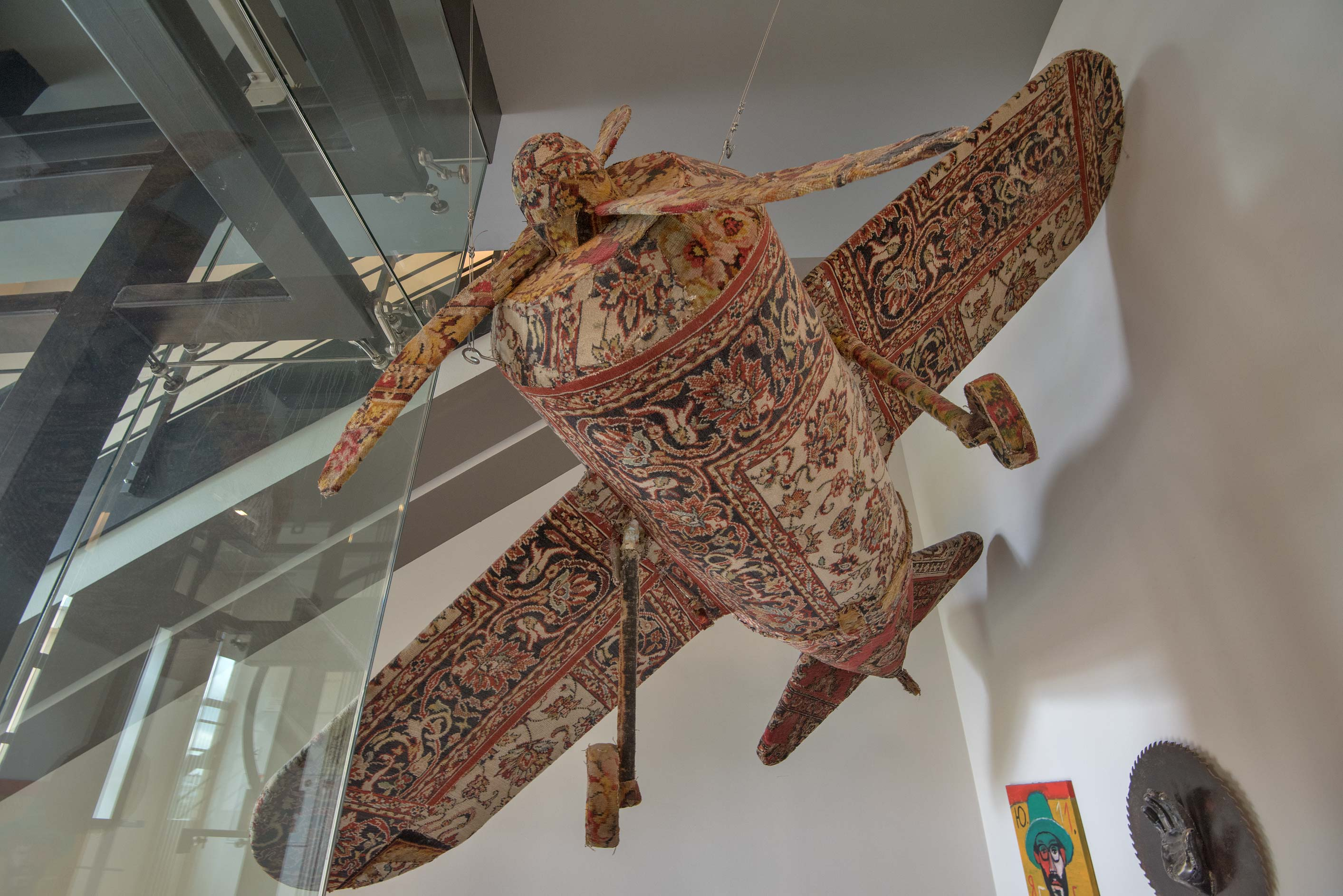 Airplane model covered by carpet in Erarta Museum...Art. St.Petersburg, Russia