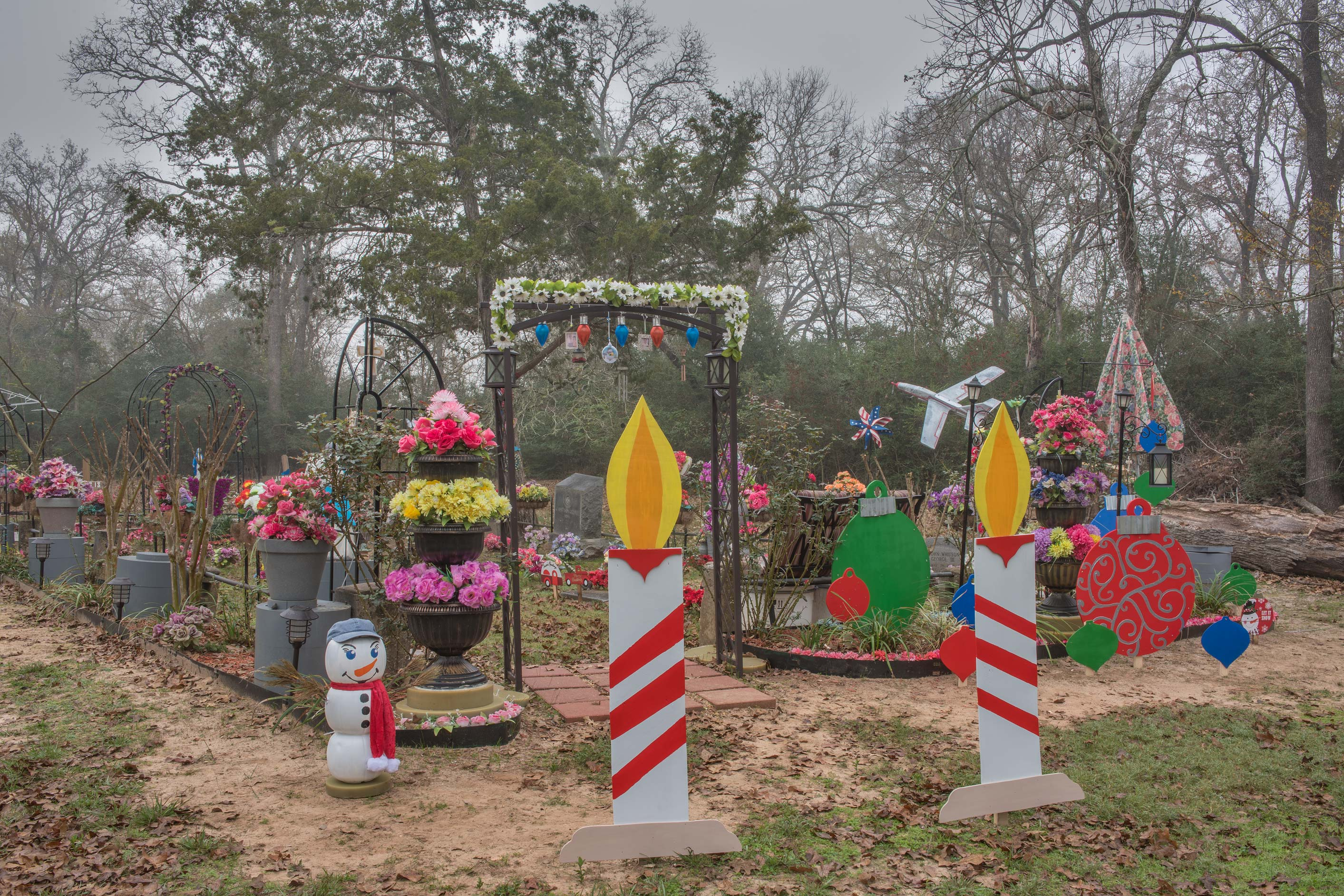 Heavy Christmas decorations in Washington Cemetery. Washington, Texas