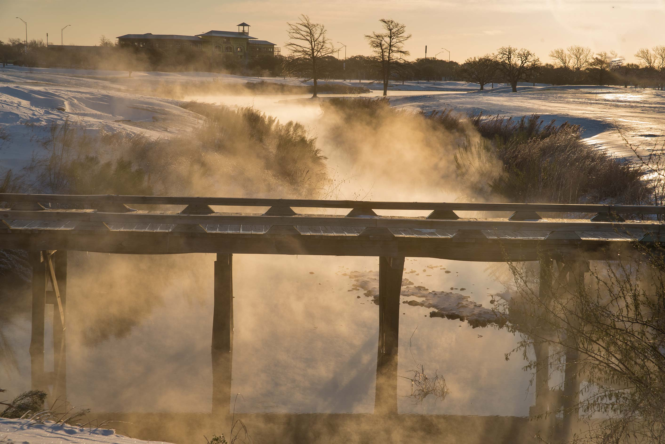 Smoky wooden bridge on a golf course on campus of...M University. College Station, Texas